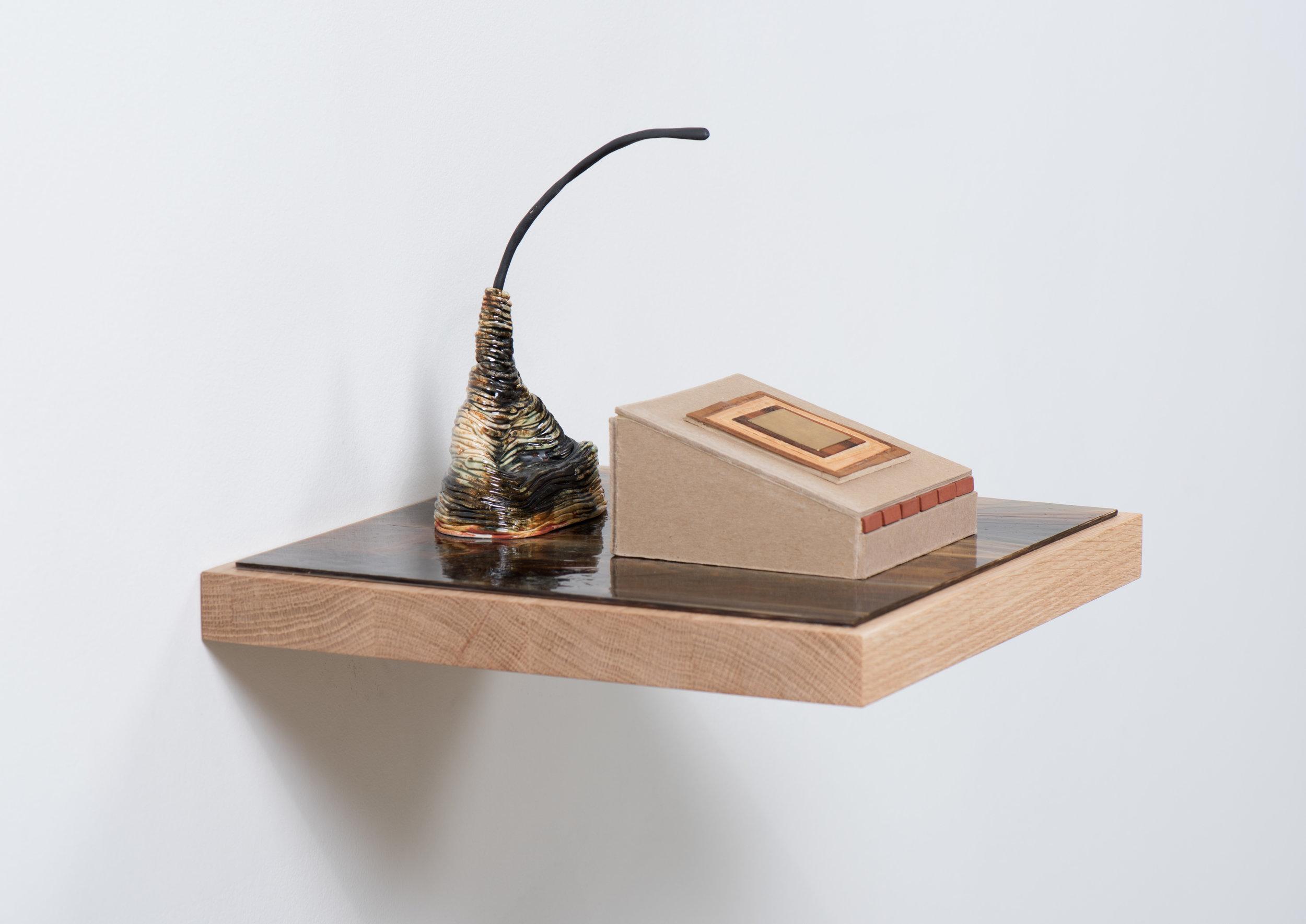 Gabrielle Ferrer  Marker , 2019 Glass, ceramic, chipboard, veneer, brass, and clay bricks 8 1/2 x 12 x 12 inches