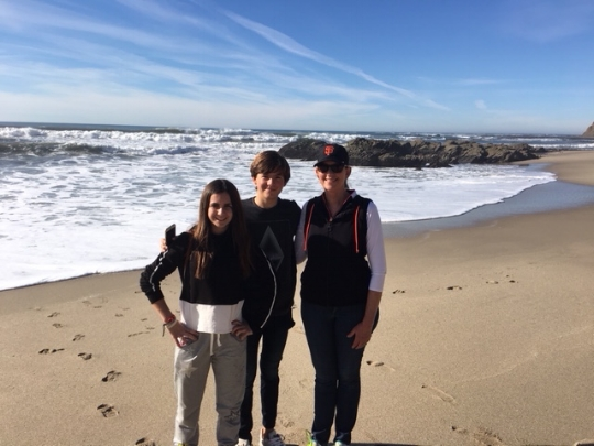 Sue with Maria and Kiko on a hike on the beach at nearby Half Moon Bay.