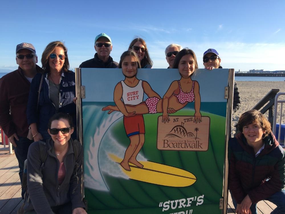 Kiko, Leah and Maria, with their Menlo host families at the Santa Cruz Beach Boardwalk