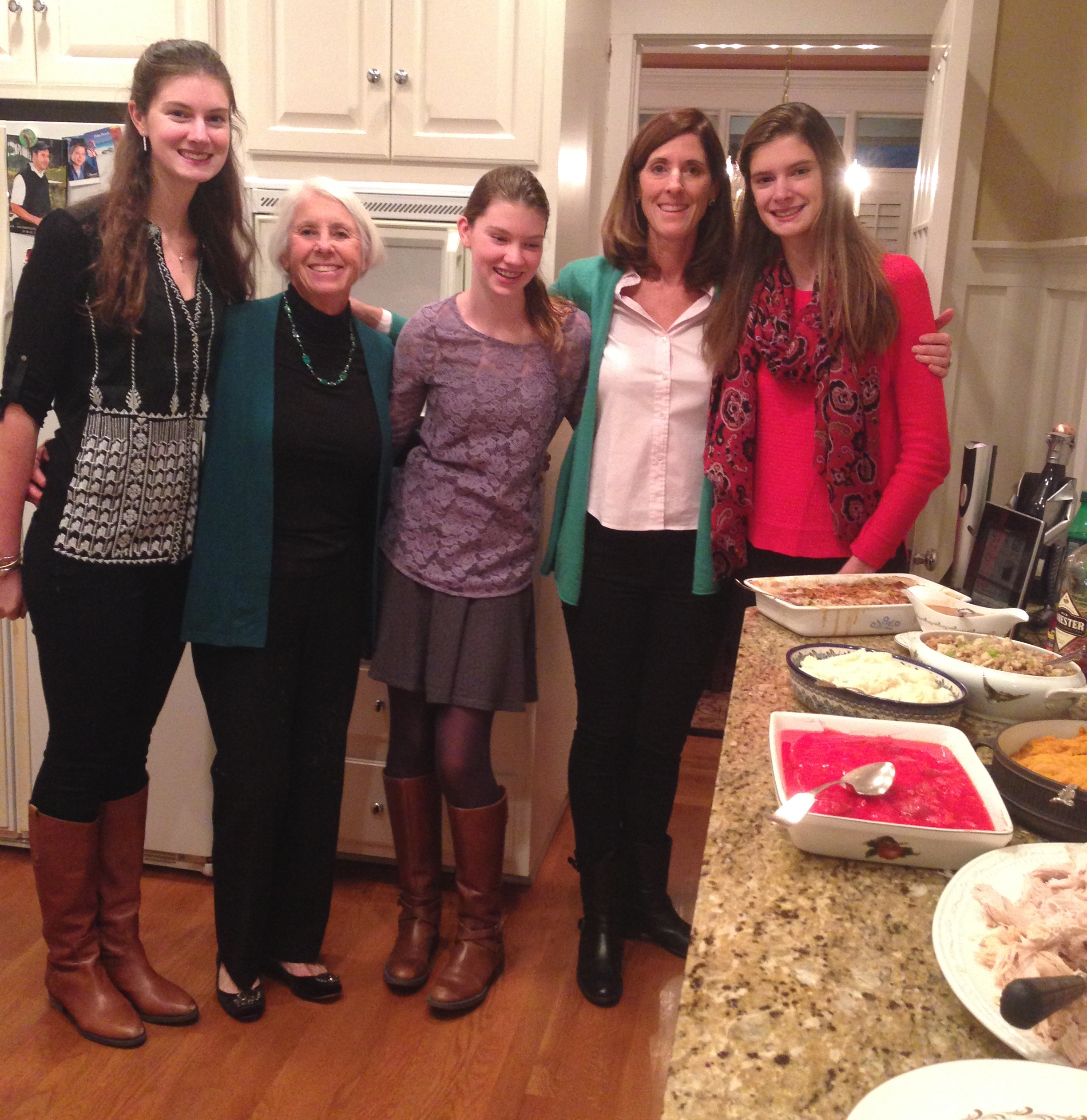 Three generations of vintage cooks! Gail Becker, at home in the kitchen with her mother and three daughters.