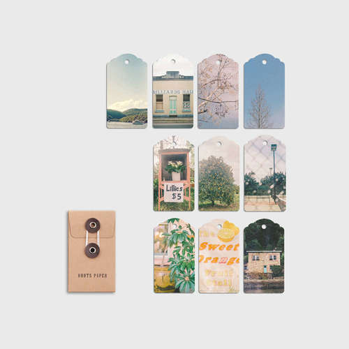 Ten swing tags, each featuring a different photograph originally captured on 35mm analogue film.
