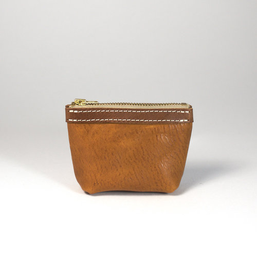 Coin Purse Mini - $44.00   Available in - Tan, Chocolate, Black and Natural  A small coin purse that fits snug in your hand. A pleasure to hold and the perfect size for all your small items. Made from vegetable tanned bovine leather, created by artisan tanners in Tuscany. The trim features a smooth traditional vegetable tanned finish and the body is dry milled to produce a naturally occurring pebbled surface.  A single compartment zip up coin purse that can fit your coins or jewellery. Featuring YKK metal teeth zippers. The Coin Purse Mini is handcrafted in Melbourne by Japanese trained leather artist, Sarah.    DIMENSIONS: 11cm x 3.5cm (base) x 8cm (LWH)
