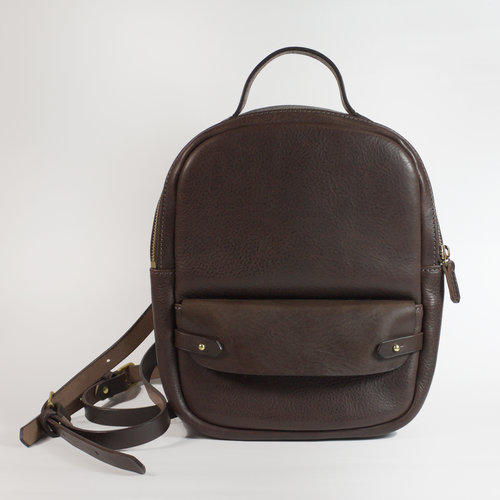 Day Pack - $330.00   Available in - Chocolate and Black  The Day Pack is perfect for travel and everyday use. It fits all the daily essentials and is the same size as a shoulder bag, but the back pack design keeps you hands-free. Made from vegetable tanned bovine leather, created by artisan tanners in Tuscany. The flap, strap and front tabs feature a smooth traditional vegetable tanned finish and the body is dry milled to produce a naturally occurring pebbled surface. The Day Pack is fully lined with a natural cream coloured lightweight canvas in 100% cotton. The small separate front pocket fits a phone, makeup items, small card wallet or similar case. The Mini Day Pack is hand crafted in Melbourne by Japanese trained leather artist, Sarah.   DIMENSIONS: 27cm x 21cm x 7cm (HWD)