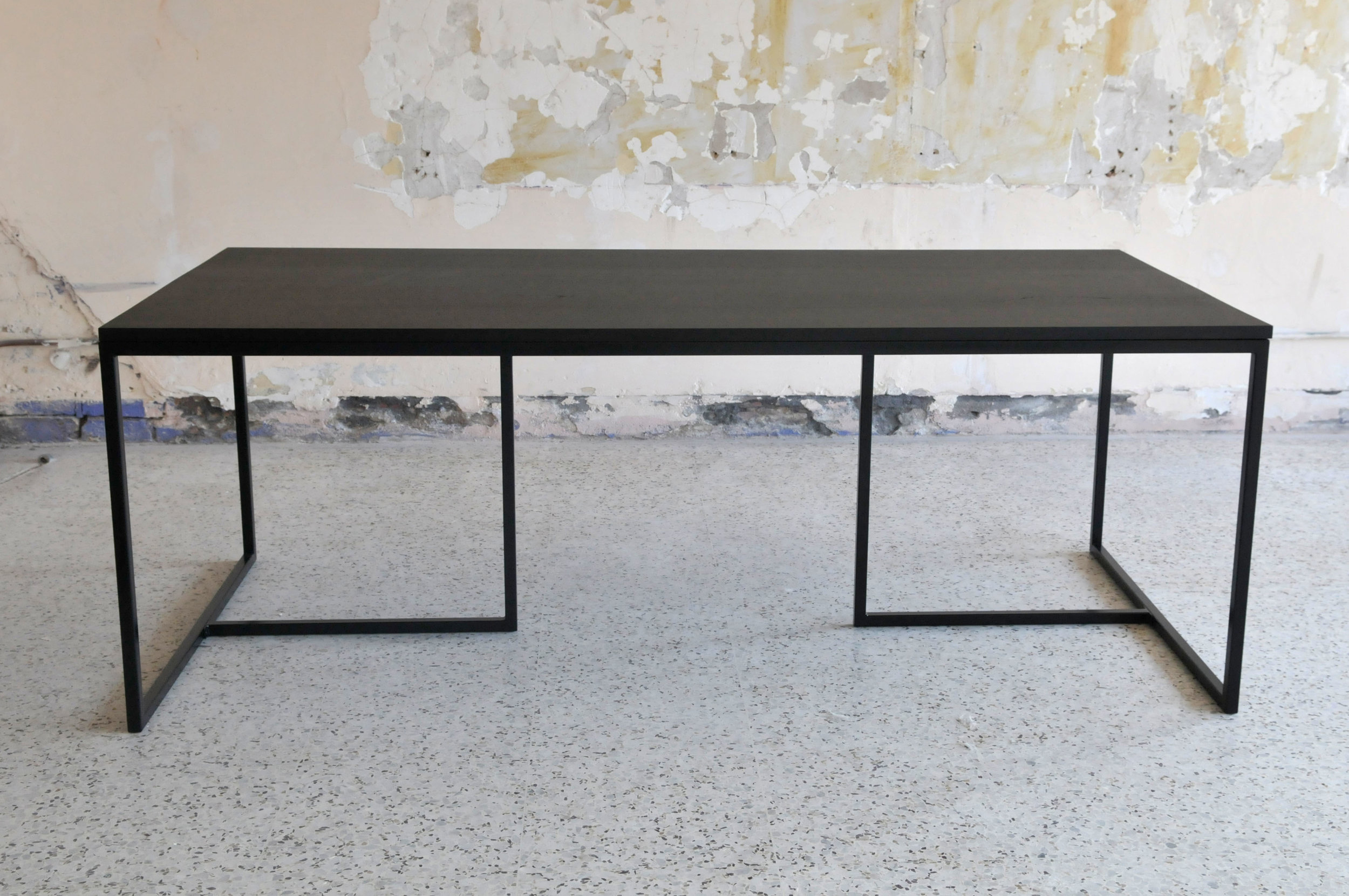 Kupa 6-8 Seter Dinning table $2,500.00   The minimalist aesthetic of this collection champions clean lines and stylish functionality.  All pieces are Victorian Ash stained matte black, on top of powder-coated black steel frames.