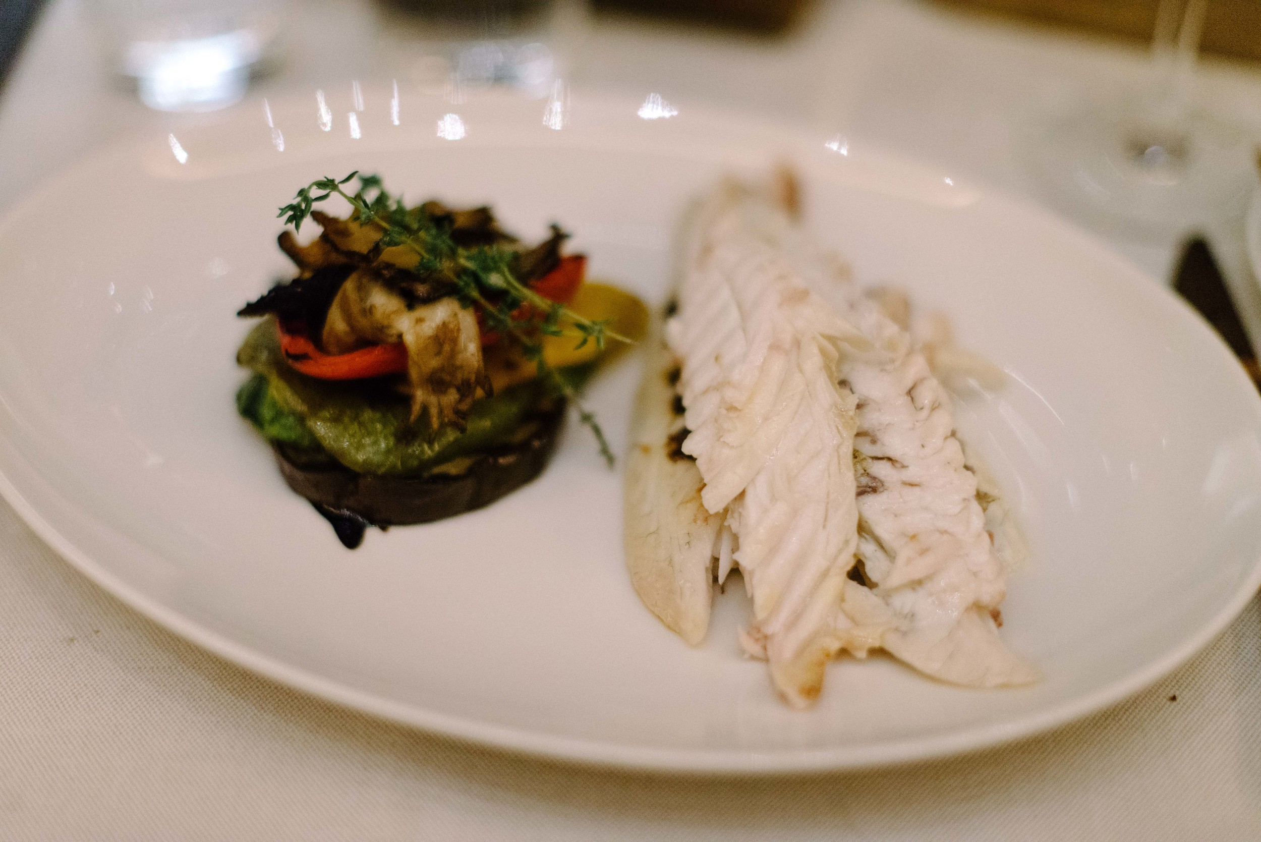 Grilled fish of the day with sautéed vegetables and thyme.