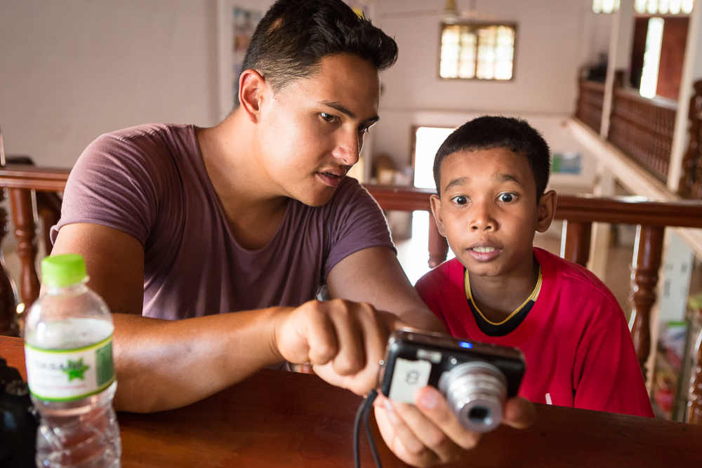 TGL team member Christian Clowes works with a student from Anjali on composition and technique after a photowalk around Siem Reap.