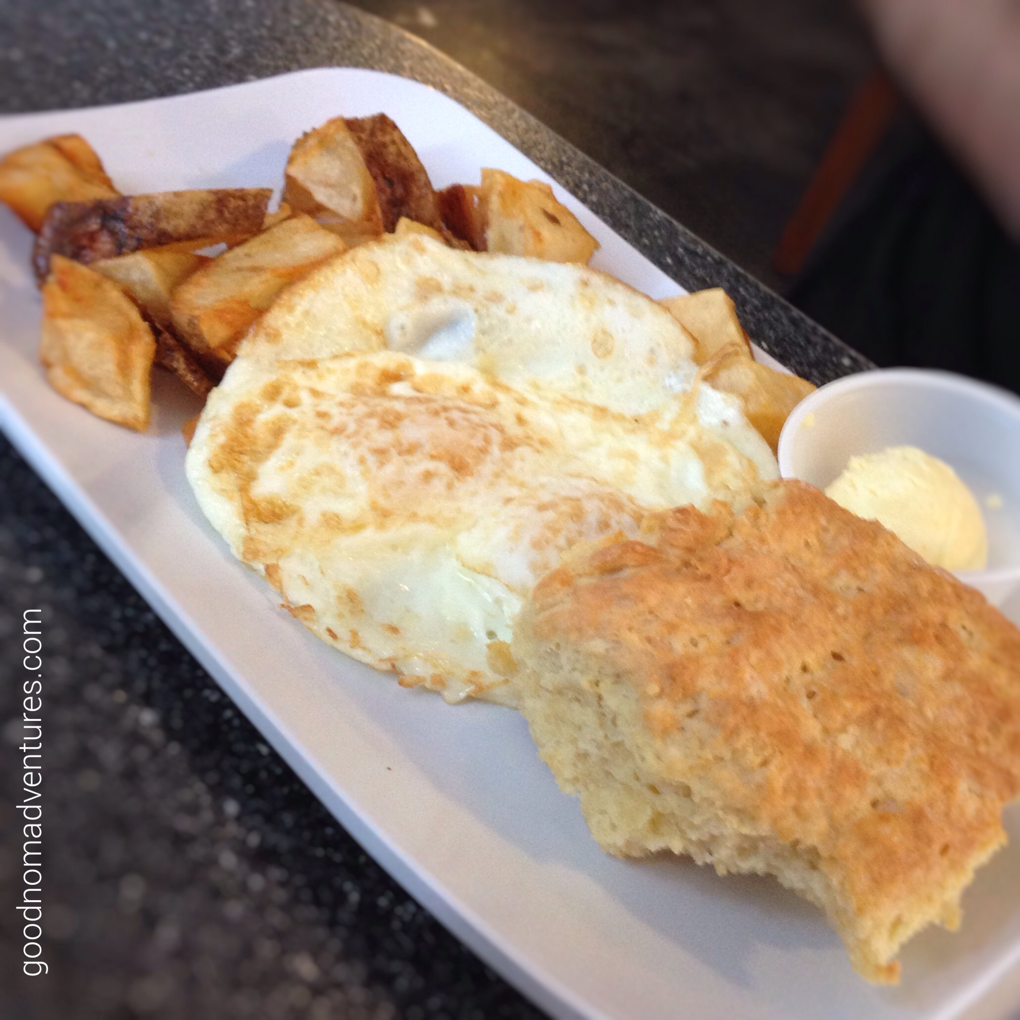 Home fries, eggs and biscuit