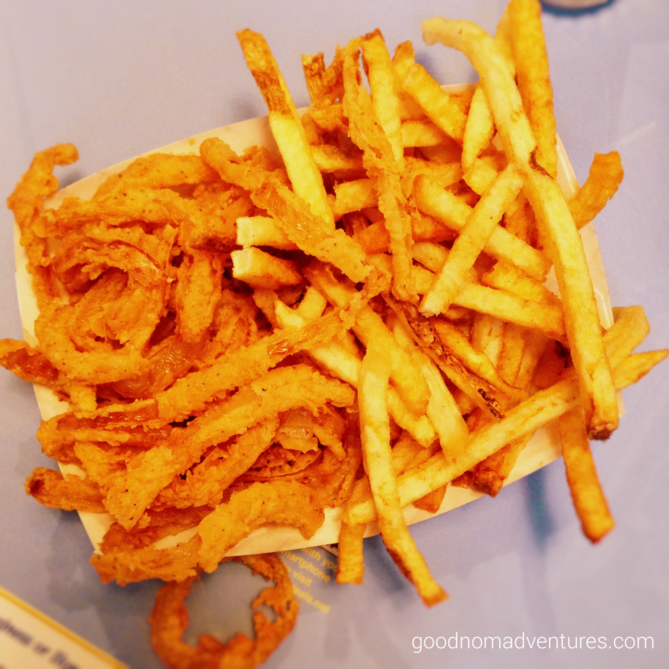 Half and half of fries and onion rings