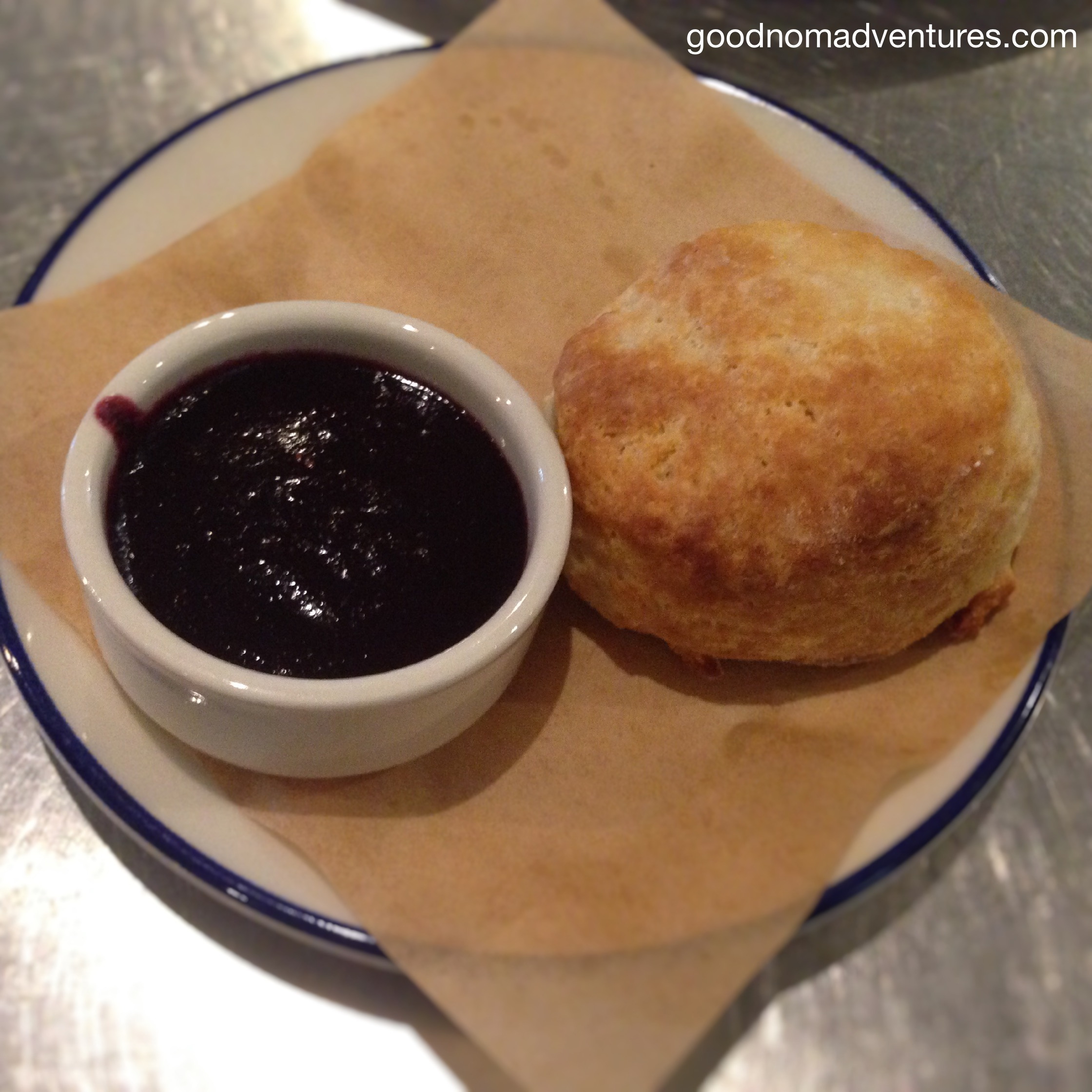 Warm biscuit with seasonal berry jam