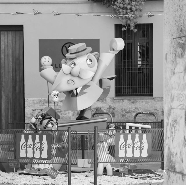 """An older gentlemen rationing happiness."" ◾️◼️🐍 •• March of this year, I had the opportunity to visit Valencia during the fallas festival. The Falles is a traditional celebration held in the city of Valencia, Spain. During the two week event, monuments spread out across the city depict satirical and cartoonish representations of modern and historical social themes. Spectators from around the world admire their beauty and artistic qualities before being burnt down in a cathartic display of reflection, destruction, and regeneration. •• #fallasvalencia #valencia #spain🇪🇸"