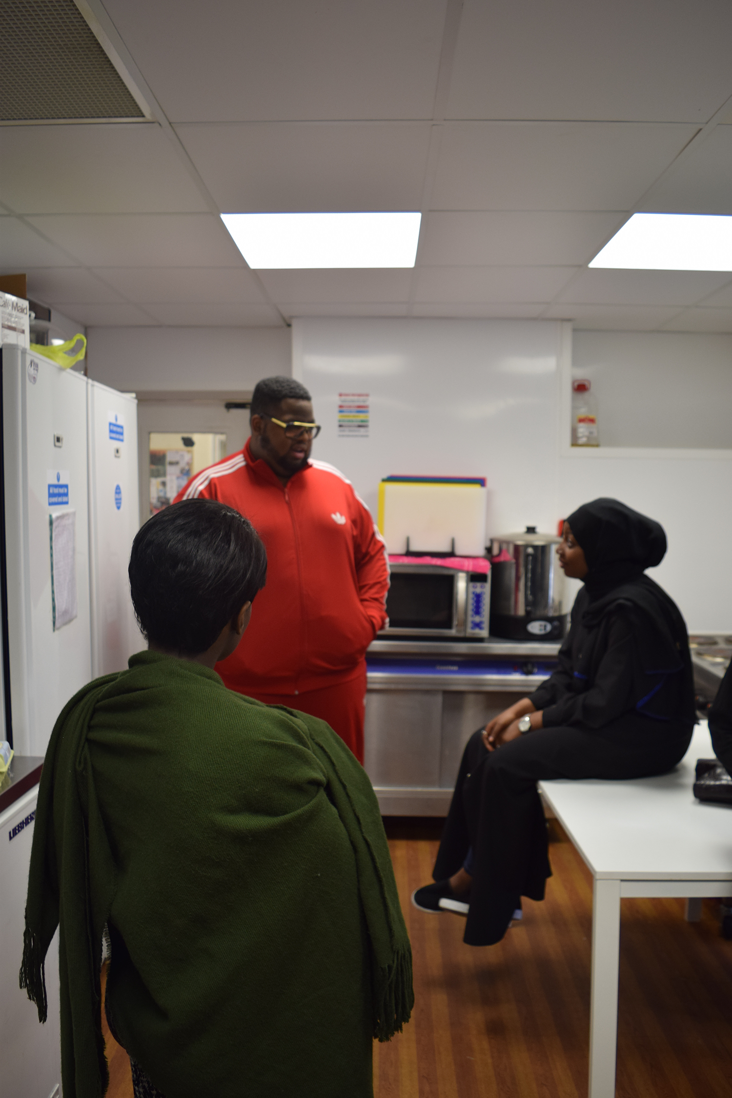 Donating food and cooking for the homeless at Brixton Soup Kitchen