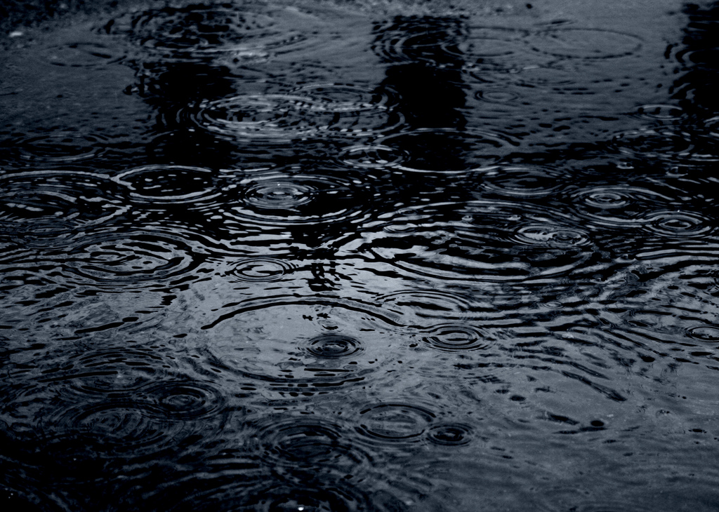 """Moody Raindrops in Dark Blue Puddle"" by Pink Sherbet Photography. Via  Flickr  and courtesy a  Creative Commons  license."