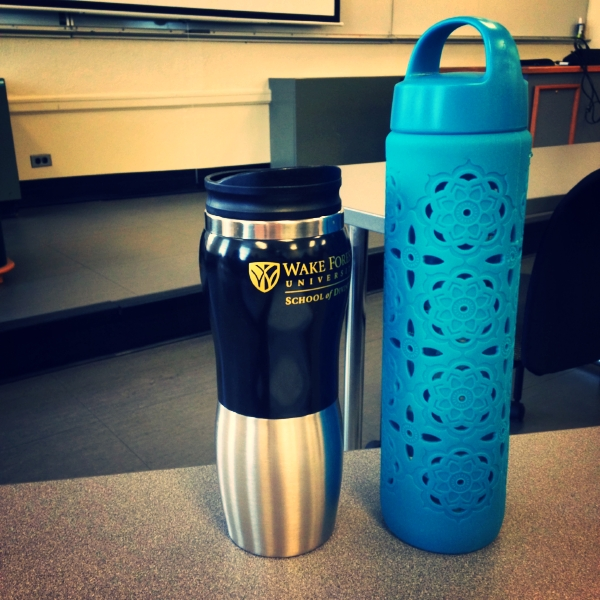 My  trusty coffee thermos  and pretty water bottle with me on the first day of spring semester this year.