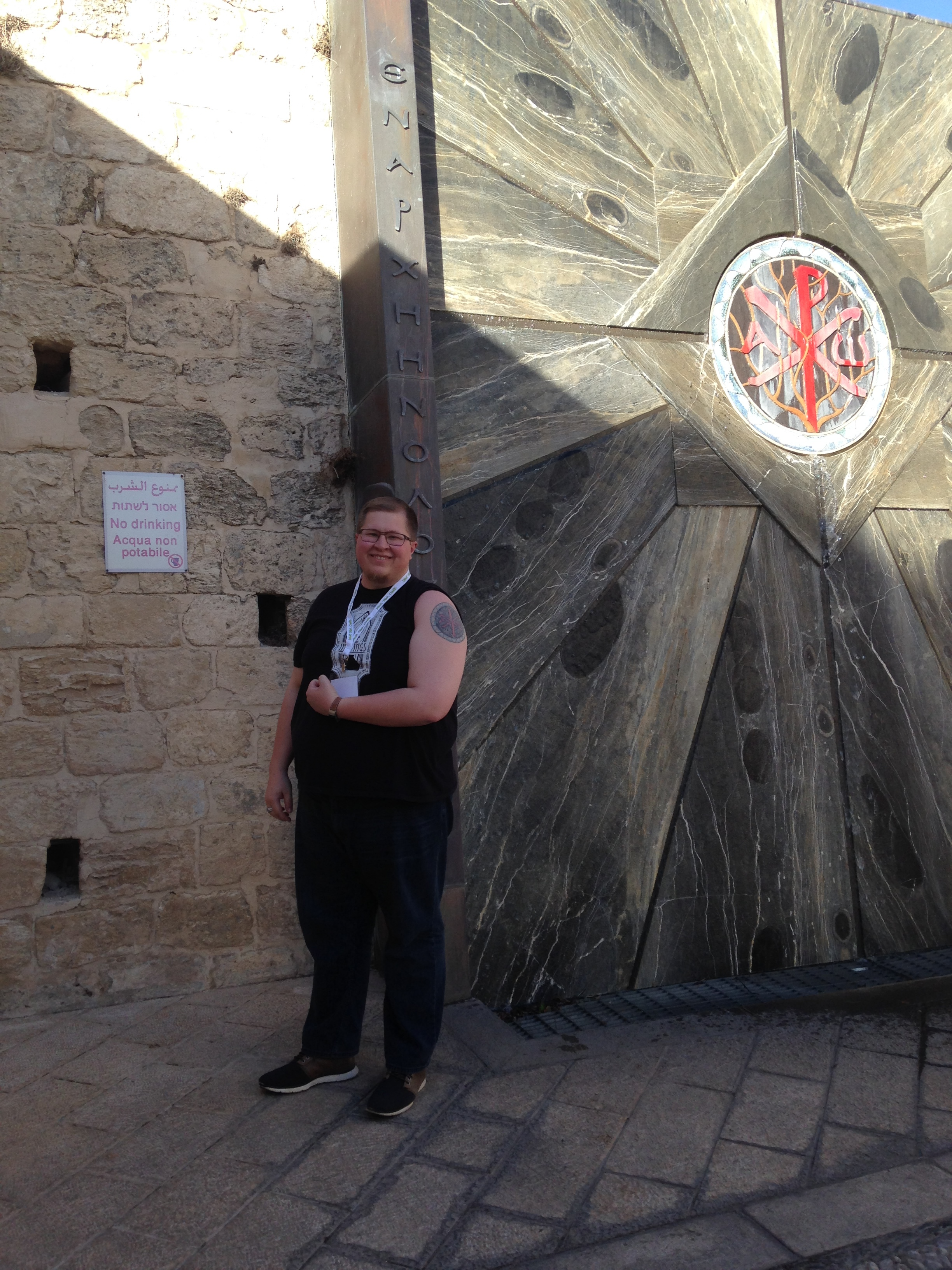 (Aaron with one of his favorite emblems of the Chi Ro in Nazareth, Israel.)