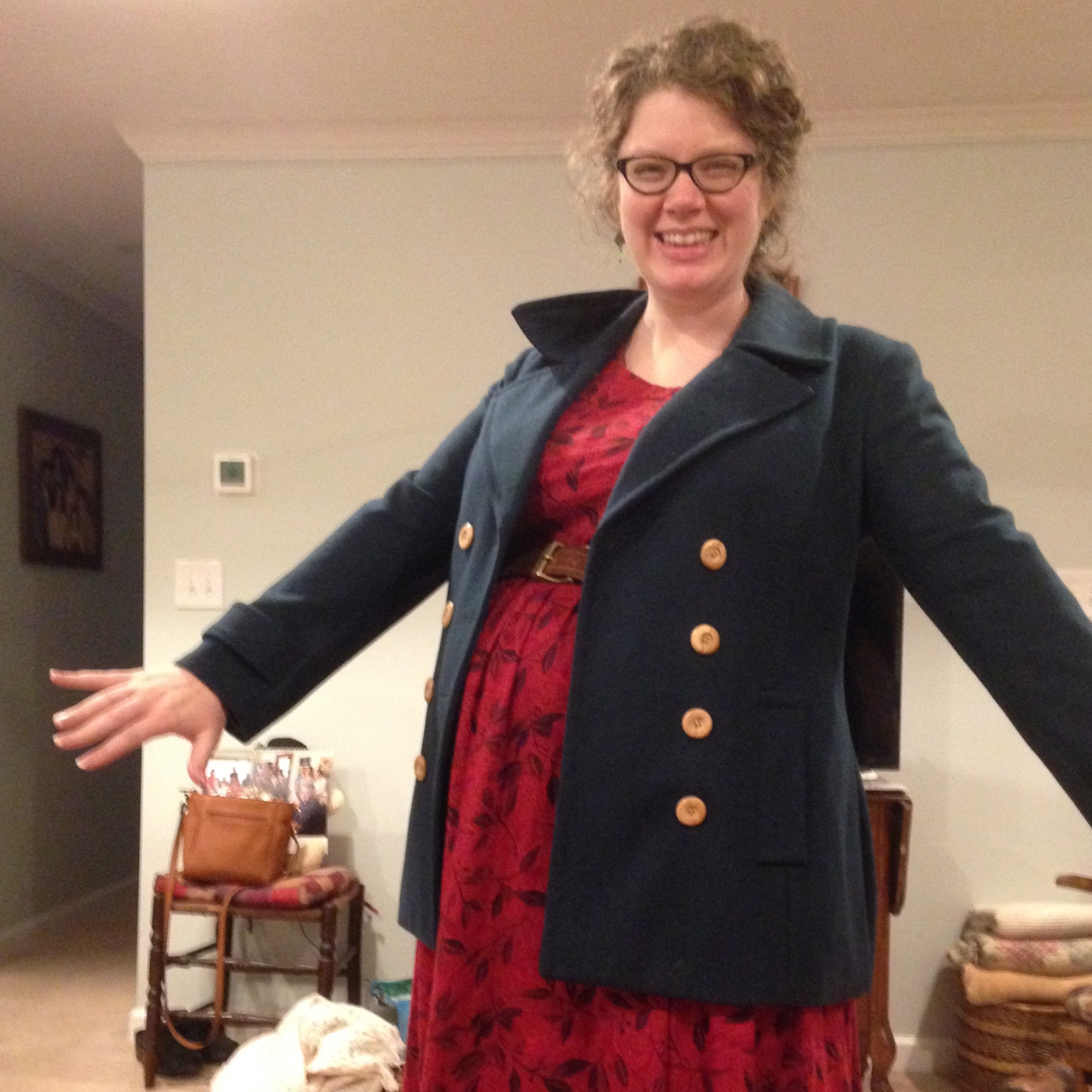 (Recent mending project: All the buttons kept falling off my coat—like, the first one fell off the first day I wore it! And I don't even USE the buttons! I installed new ones.)