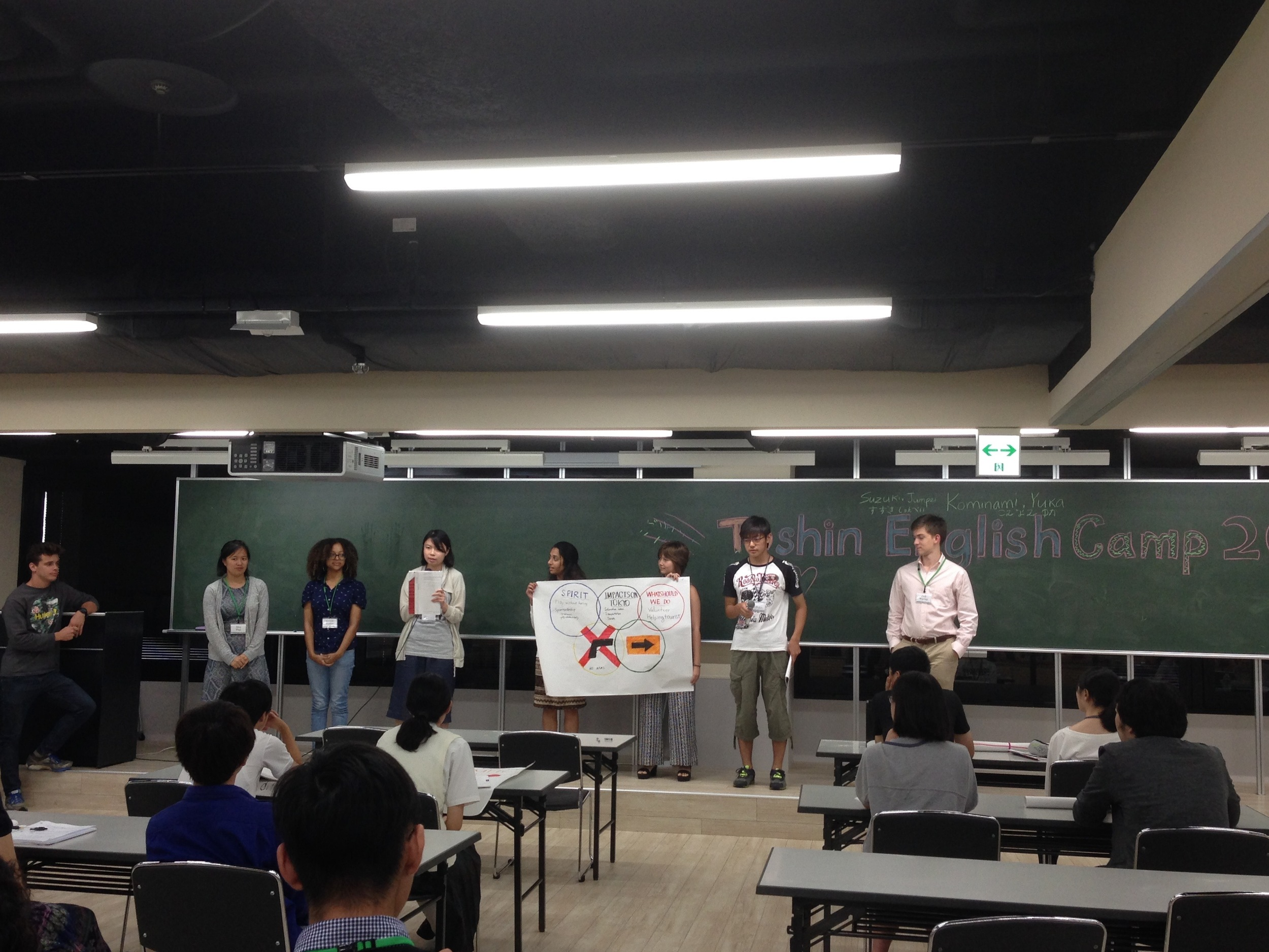 Japanese students present alongside their intern mentors.