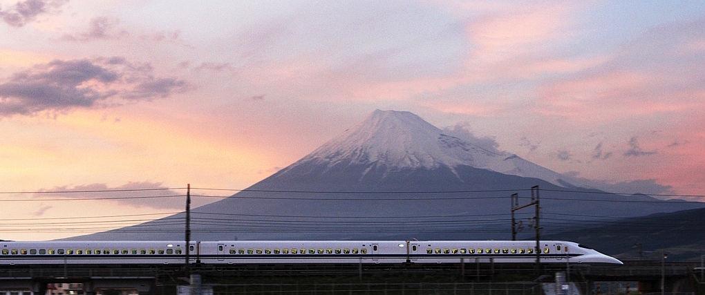 A  shinkansen train passes by Mount Fuji in Shizuoka Prefecture.