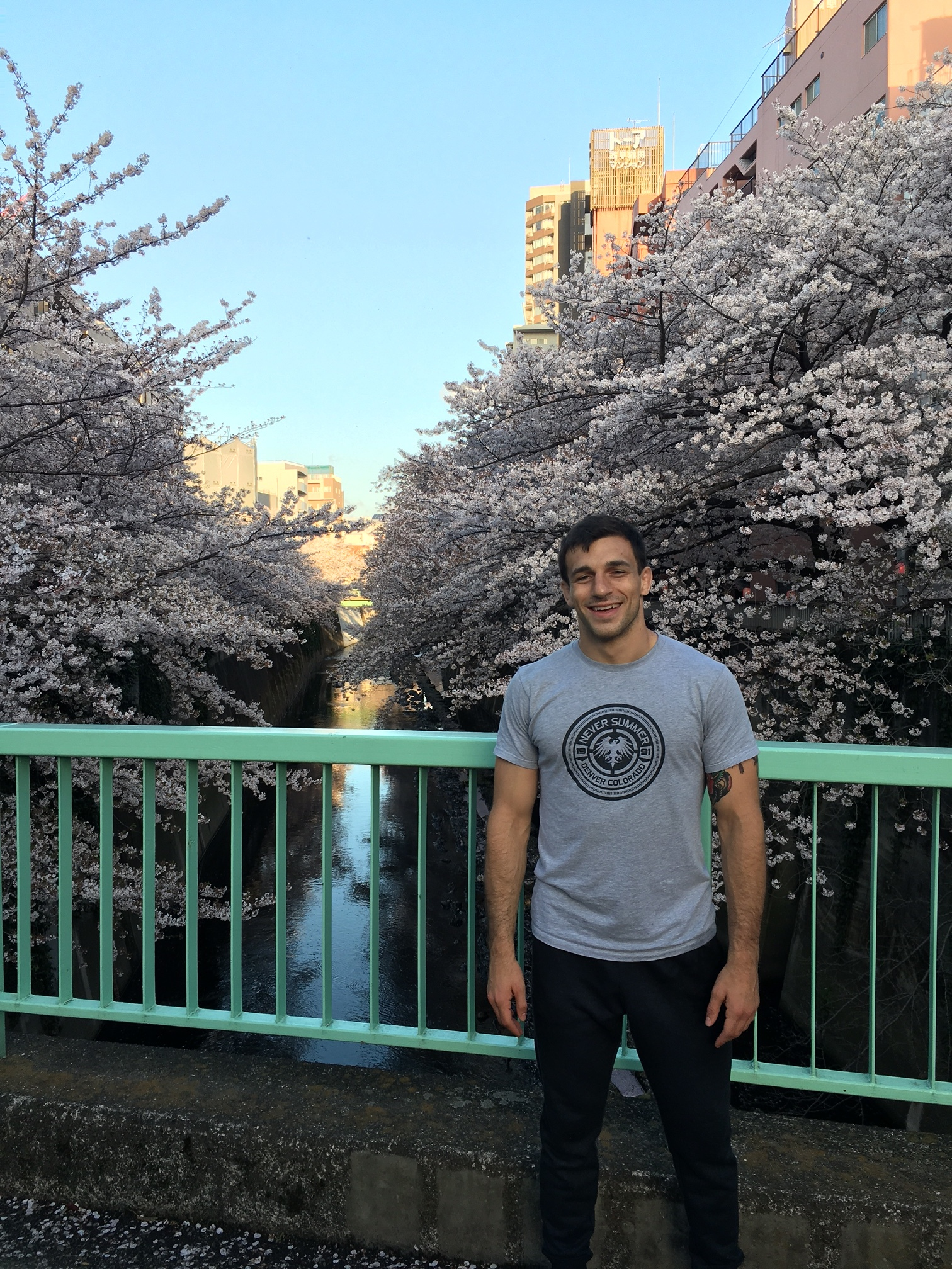 Shameless shot of me by the river near my university, enjoying one of the last days of the  hanami season. Sometimes the cherry blossoms are vibrant pink, and sometimes they have more of a white hue. Either way, they're beautiful and photographs can't do them true justice.