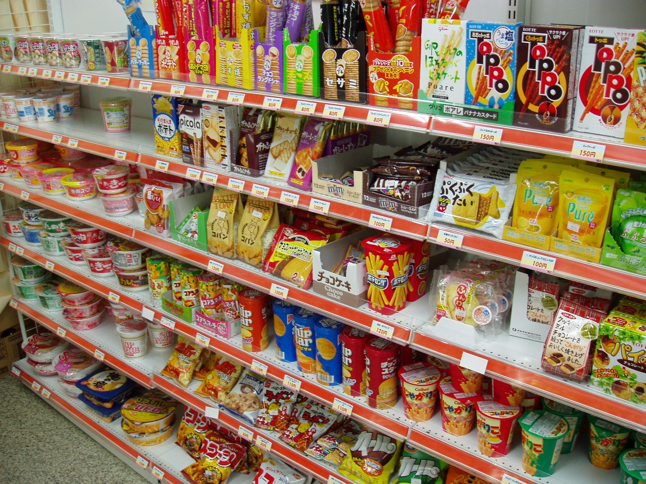 Typical snack shelf at a Japanese convenience store. I couldn't even tell you what all of these are, but I can tell you that they're likely all delicious. It's like munchie paradise.
