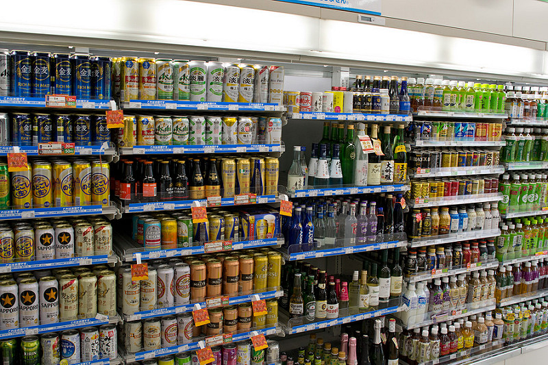 If I included a picture of one of the awesome snack shelves, I had to include a picture of the glorious drink-wall. This is a pretty common sight in any  konbini . Alcohol's nestled right up next to the soft drinks. You can usually find all 4 of the main Japanese beer brands (Sapporo, Asahi, Kirin and Suntory) as well as a million different kinds of  sake , tea, soda pop, coffee, sports drinks, etc.