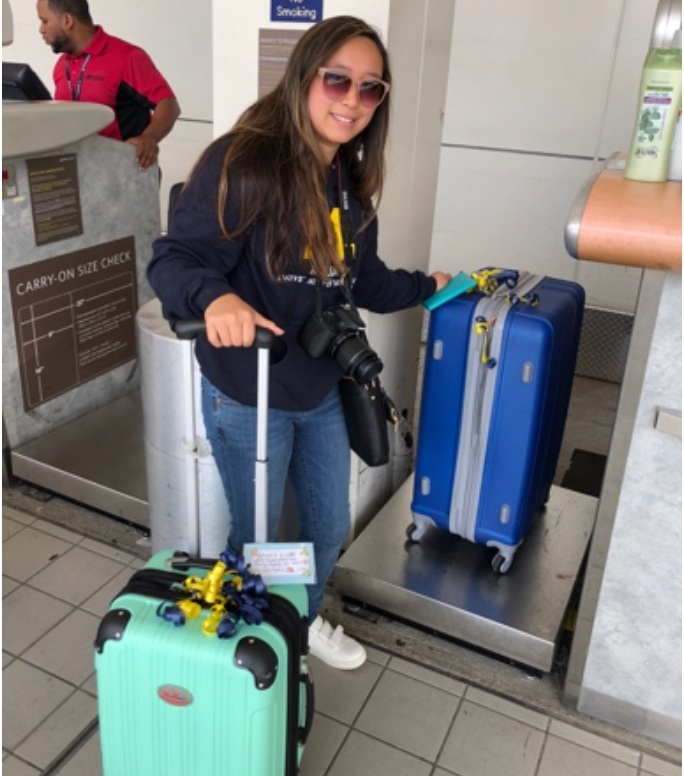 Ignorant traveler with an overweight suitcase at the airport. -