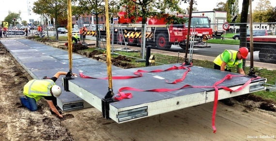 Construction of the world's first solar road in Krommenie, outside Amsterdam