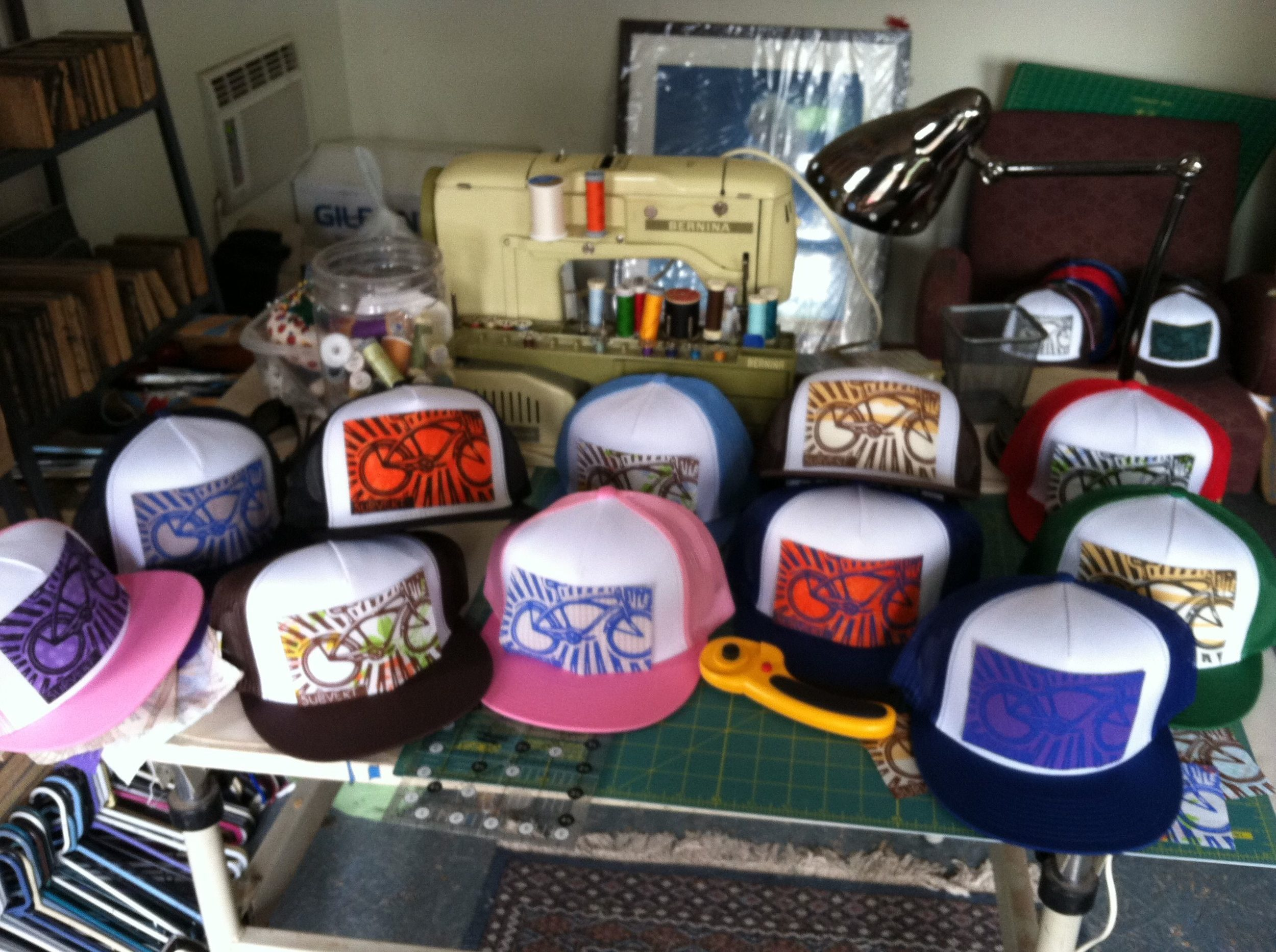 A batch of hats for Chile Pepper Bike Shop.
