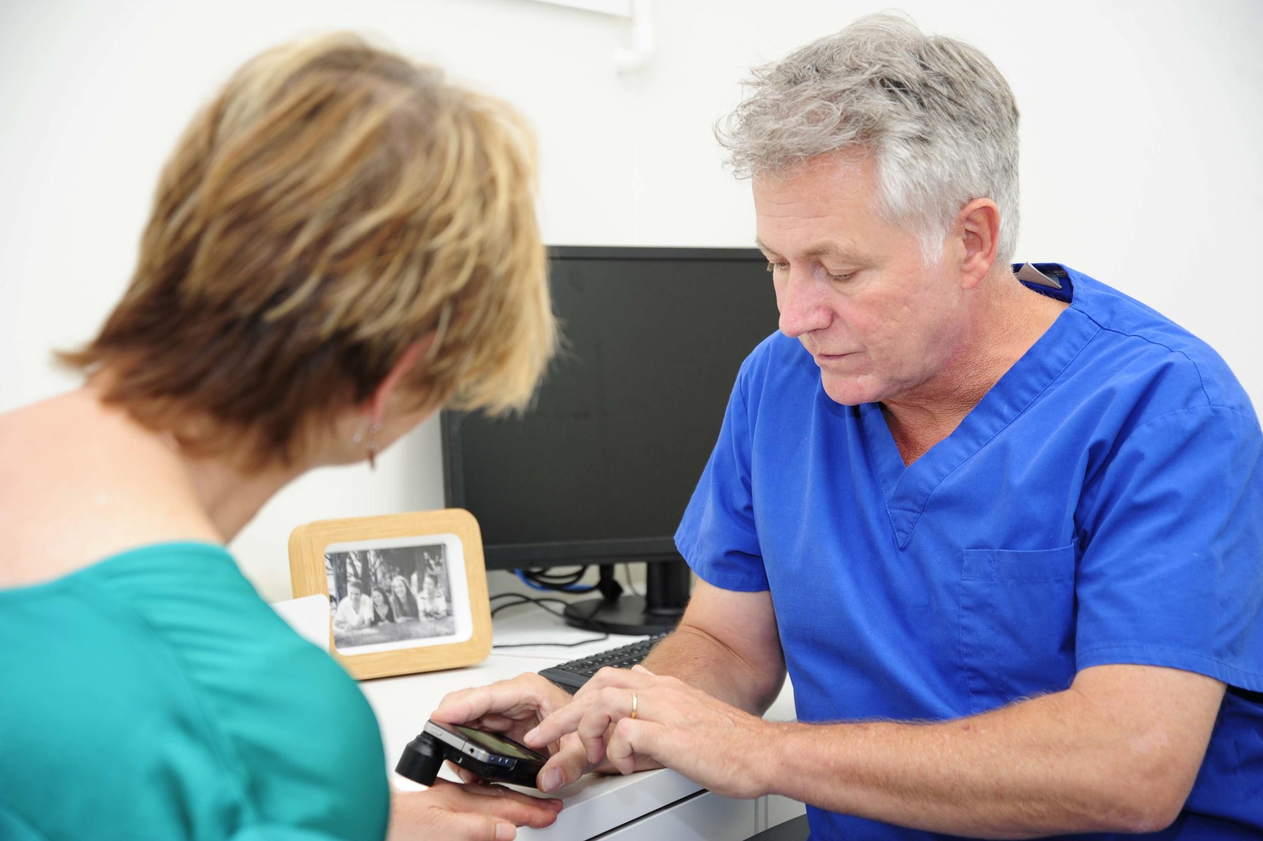 Dr Andrew MacGill examining a mole