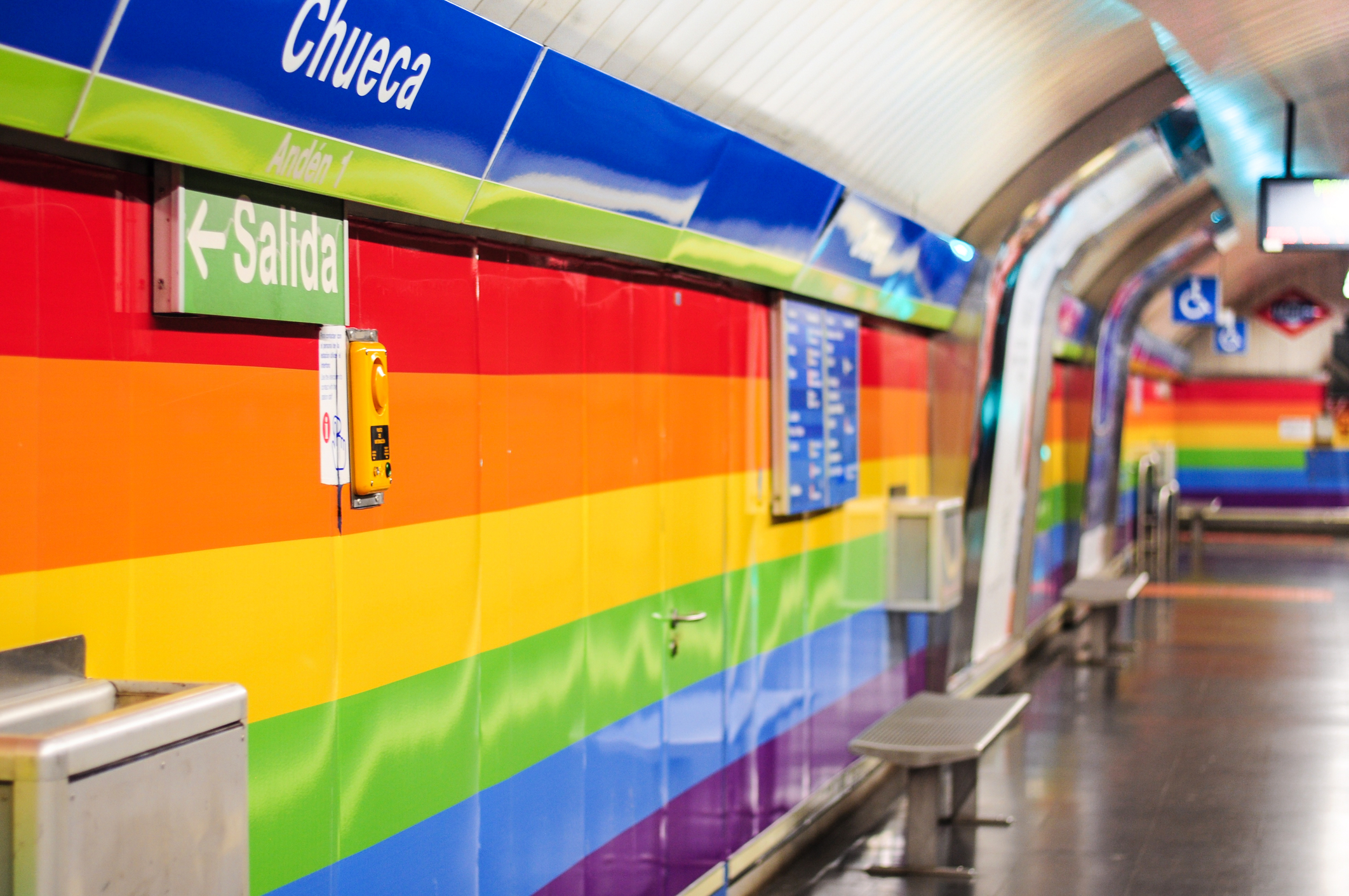 LGBT flag colours walls of the Metro station Chueca in gay district of Madrid, Spain. Made for World Pride 2017