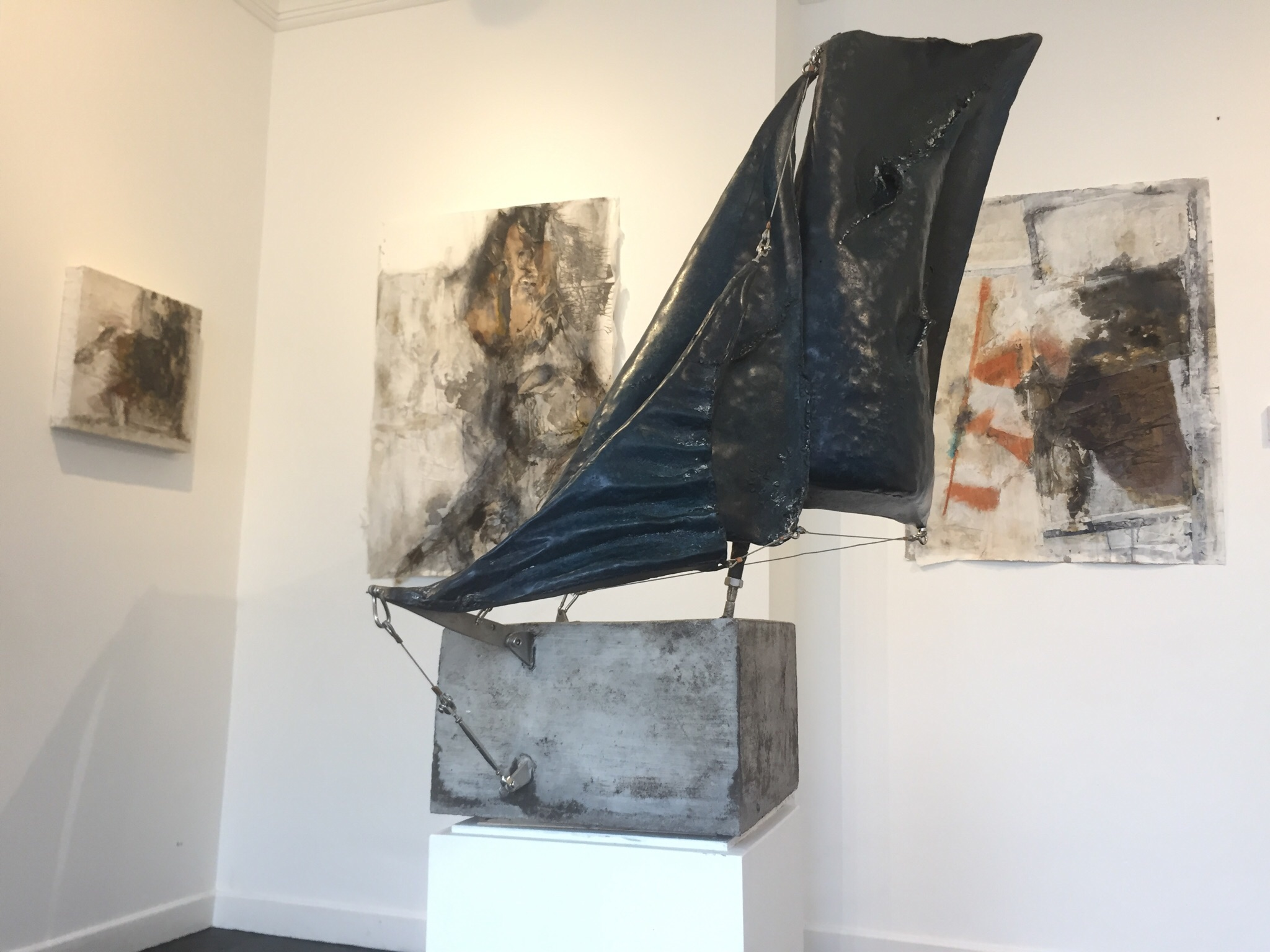 An Sgoth Eireanach II (The Irish Skiff), bronze, stainless steel and concrete.  A three-part composition of sail elements, pivoted on a single point, using rigging components and tensile structural members.