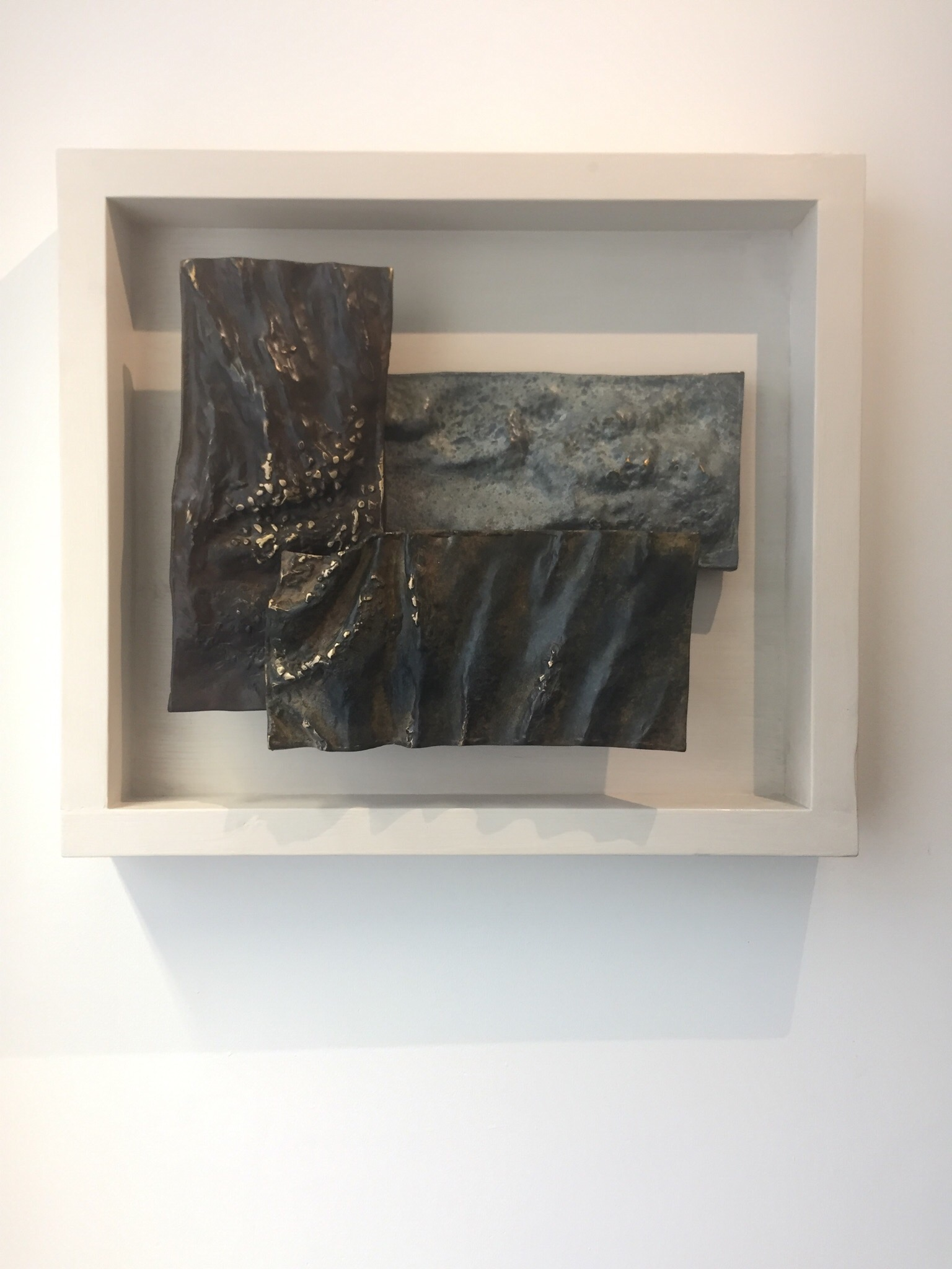 Sea, River, Sky; bronze. A wall-mounted, three-part relief composition based on the natural water cycle.