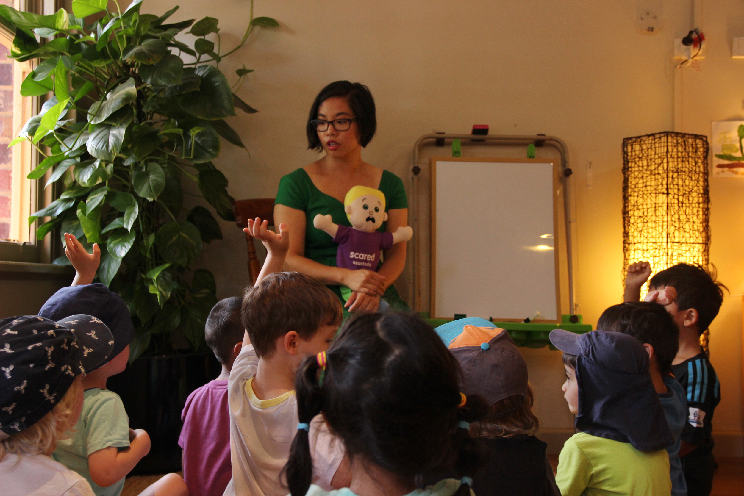 Bridge Road Early Learning Centre children learning about their feelings with co-founder Whitney Yip  Photo: Klari Agar