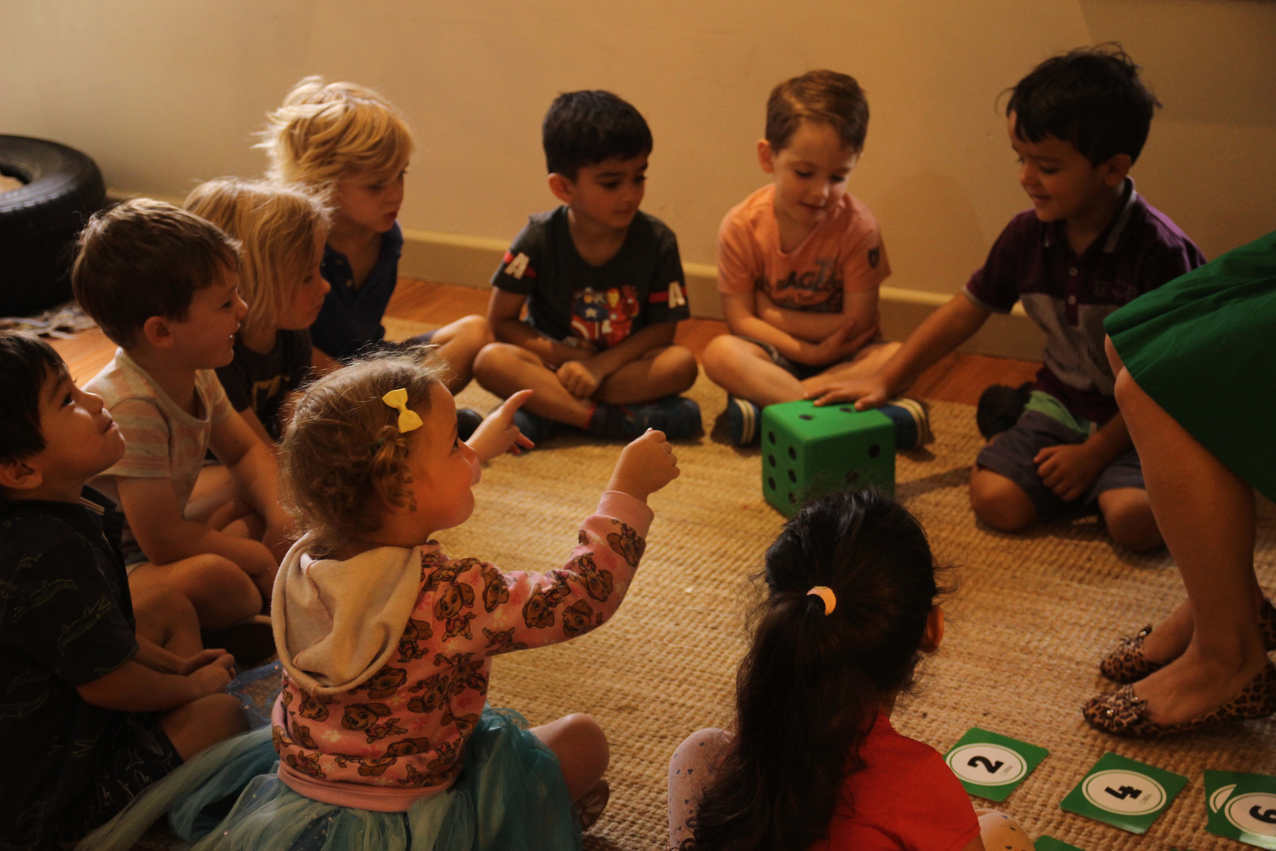 Children learning about their feelings while playing Roll 'n' Play Emotions  Photo: Klari Agar
