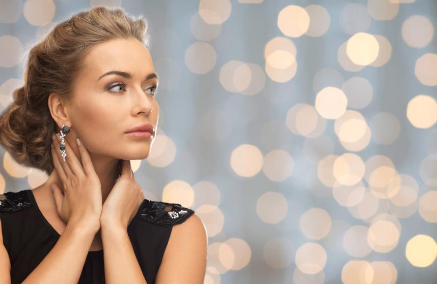 beautiful-woman-wearing-earrings-over-lights-000076750199_Small.jpg