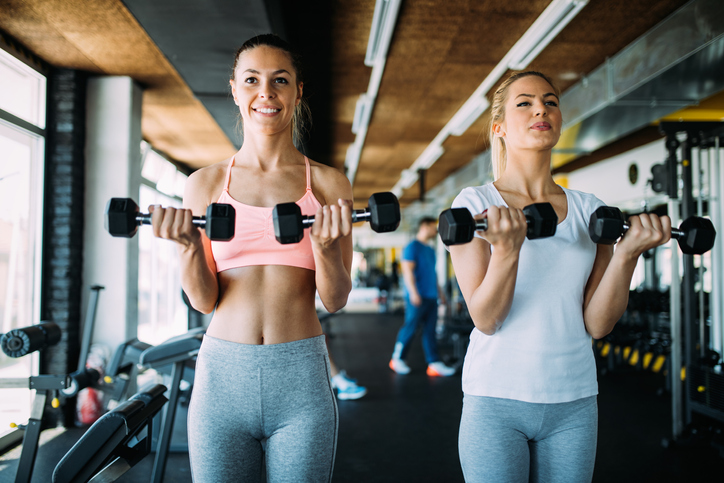 Picture of two beautiful fitness women in gym