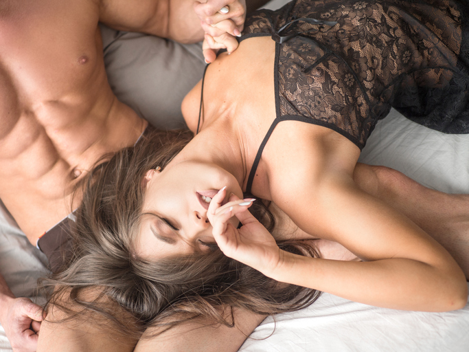 Young loving couple in the bed. love and relationship concept