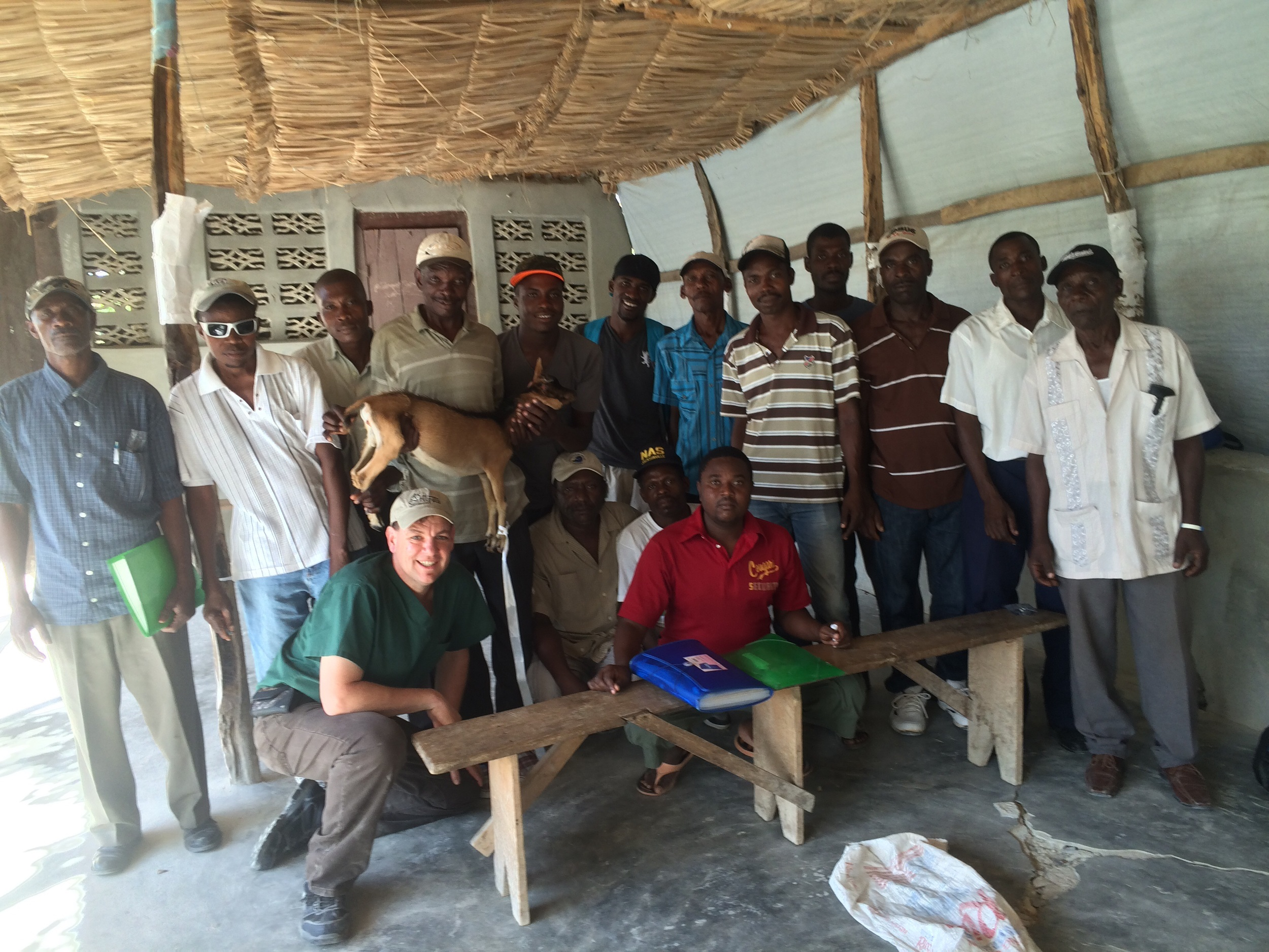 Haitian vet agents in Charye, Haiti along with the goat that was successfully delivered approximately 20 times during obstetrics training