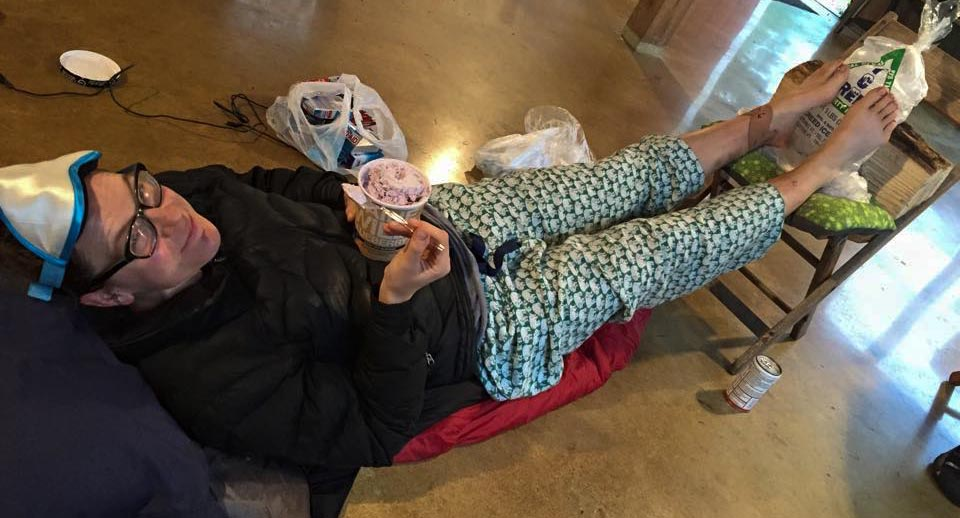 Jordan eats ice cream while elevating her legs to curb the swelling in her feet.