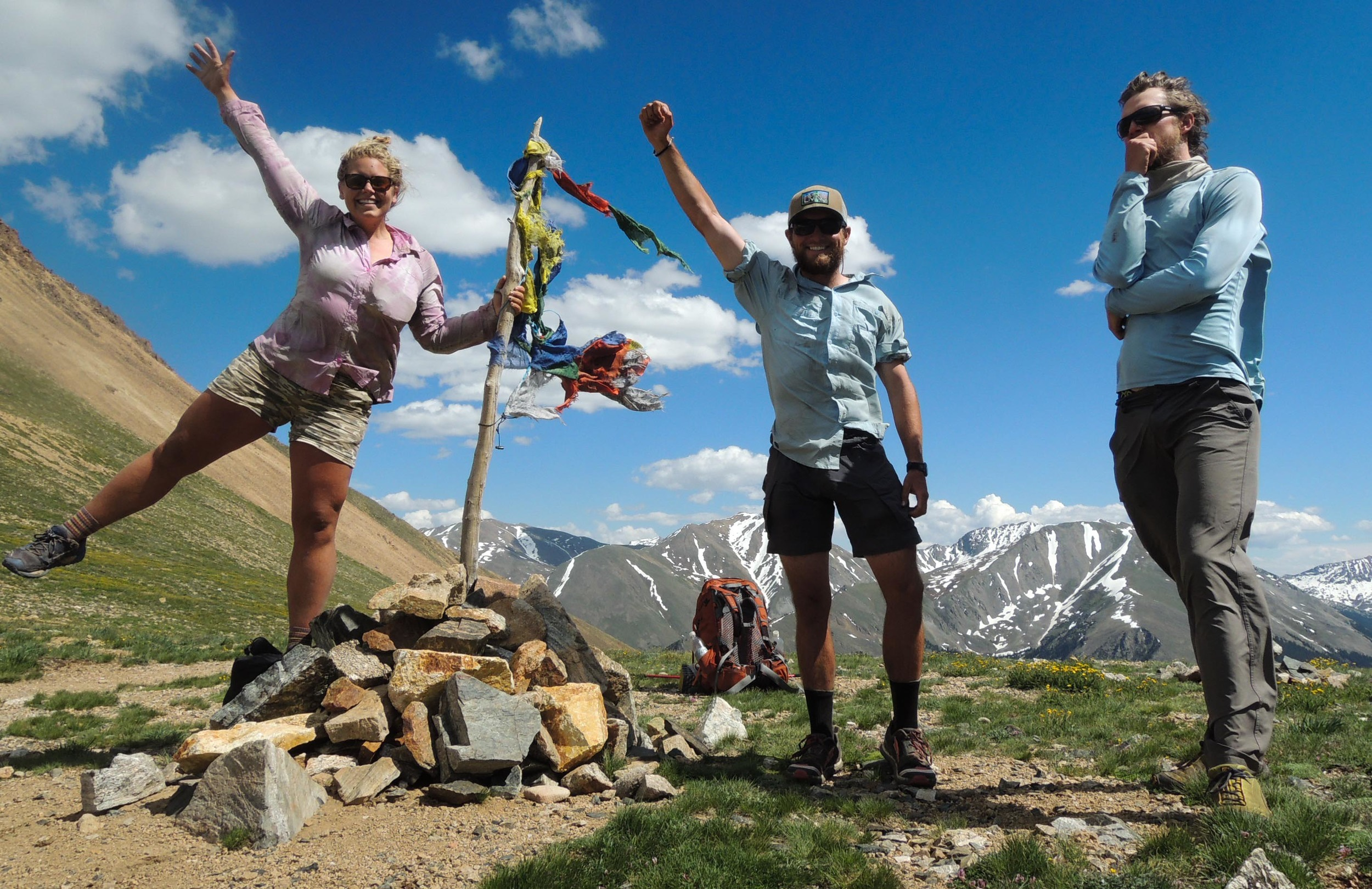 Meg Roussos, Chilton Tippin and Corey White celebrate reaching Hope Pass near Twin Lakes, Colorado.