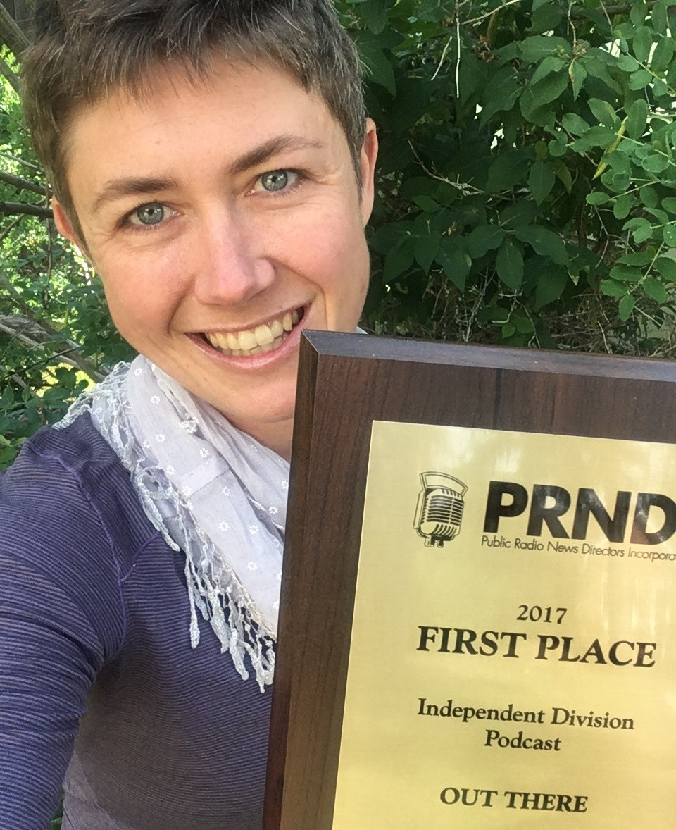 Out There Host Willow Belden displays the show's latest PRNDI award.