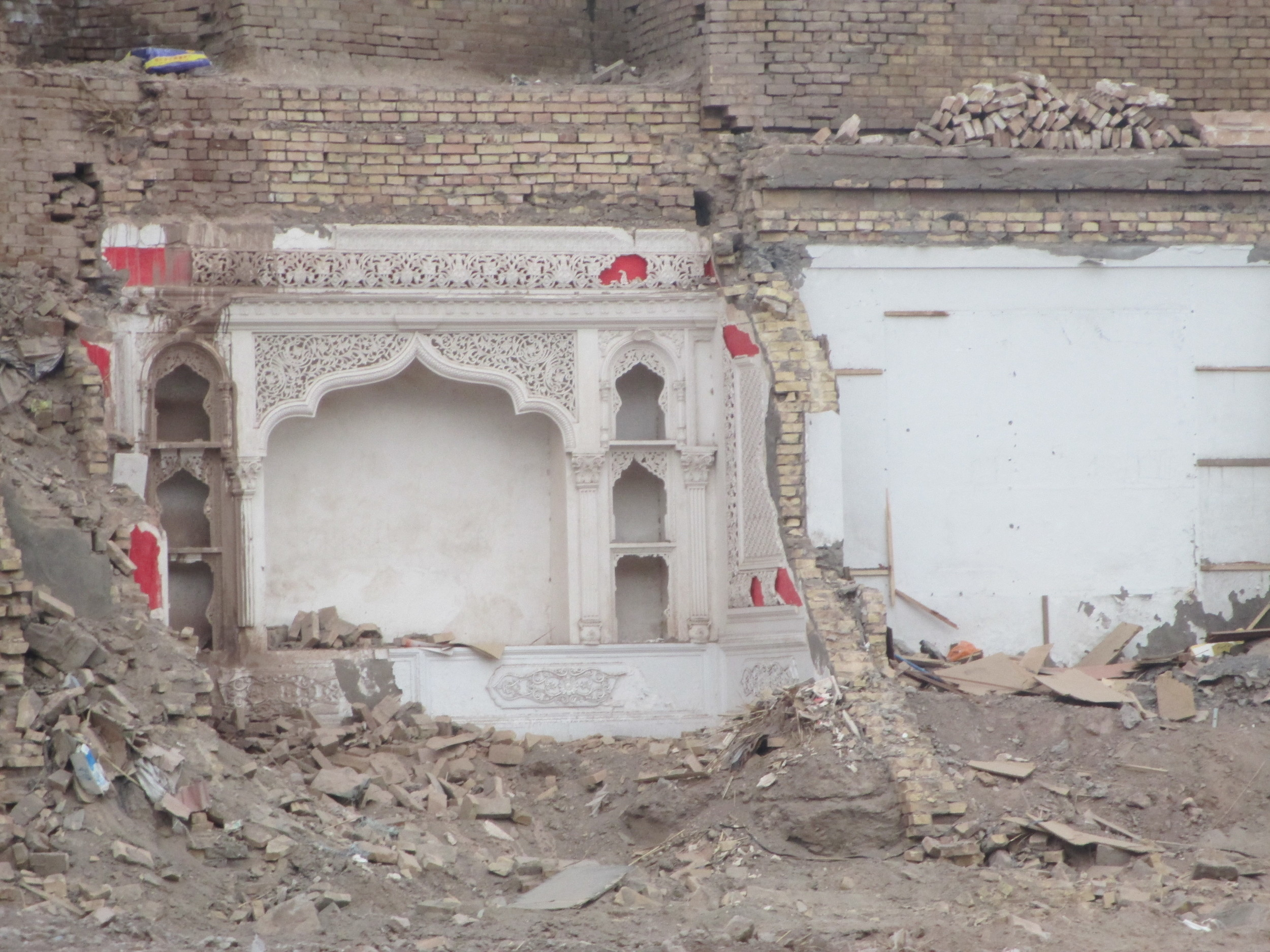 The entire old city of Kashgar is been bulldozed , here is the intricate interior of a house that is being destroyed
