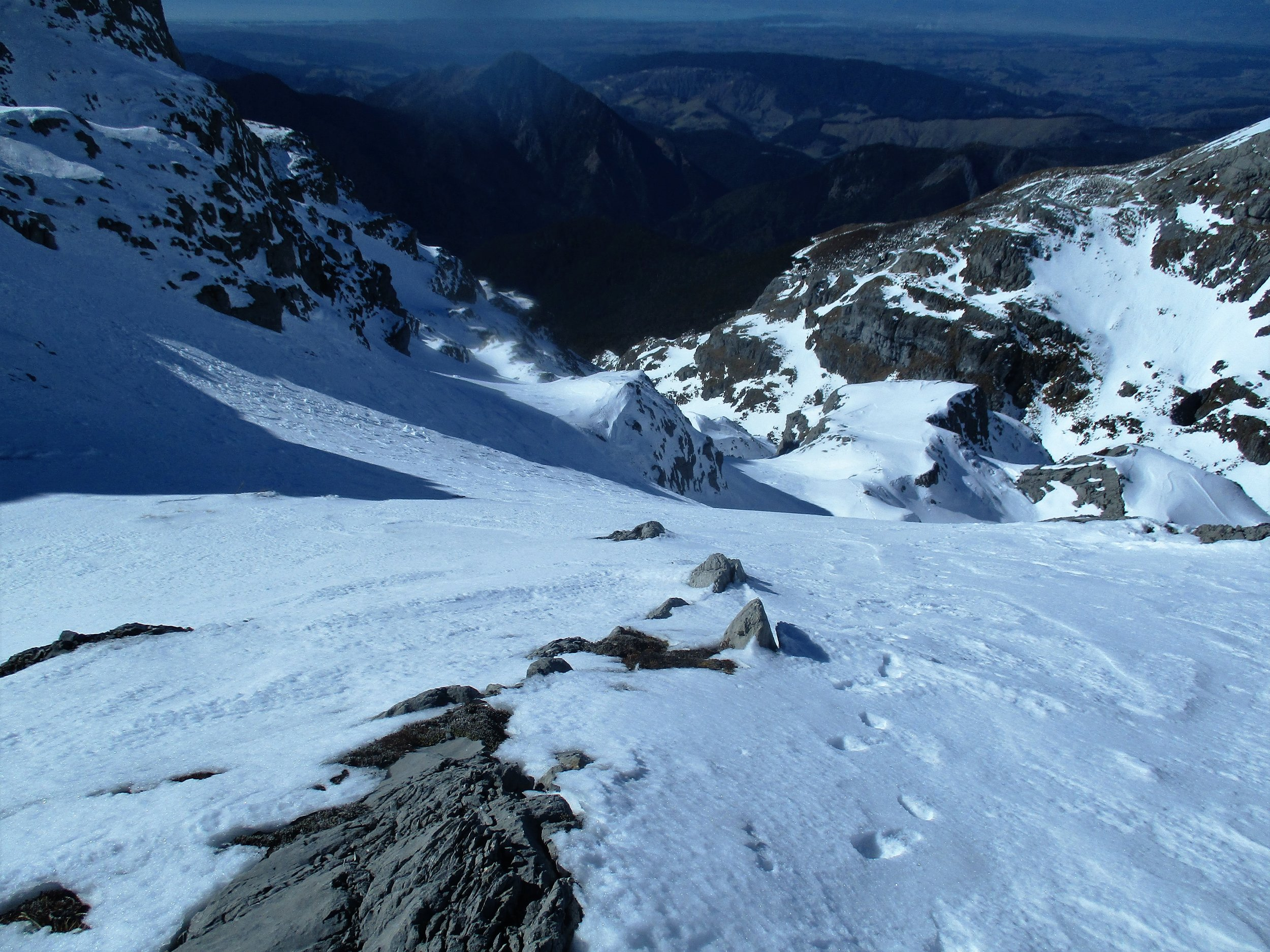 """Climbing up the east side of Winter peak , there's enough snow on the Arthur range to fill all the higher gullies and Karst """"crevasses"""" making wandering around a delight!!"""