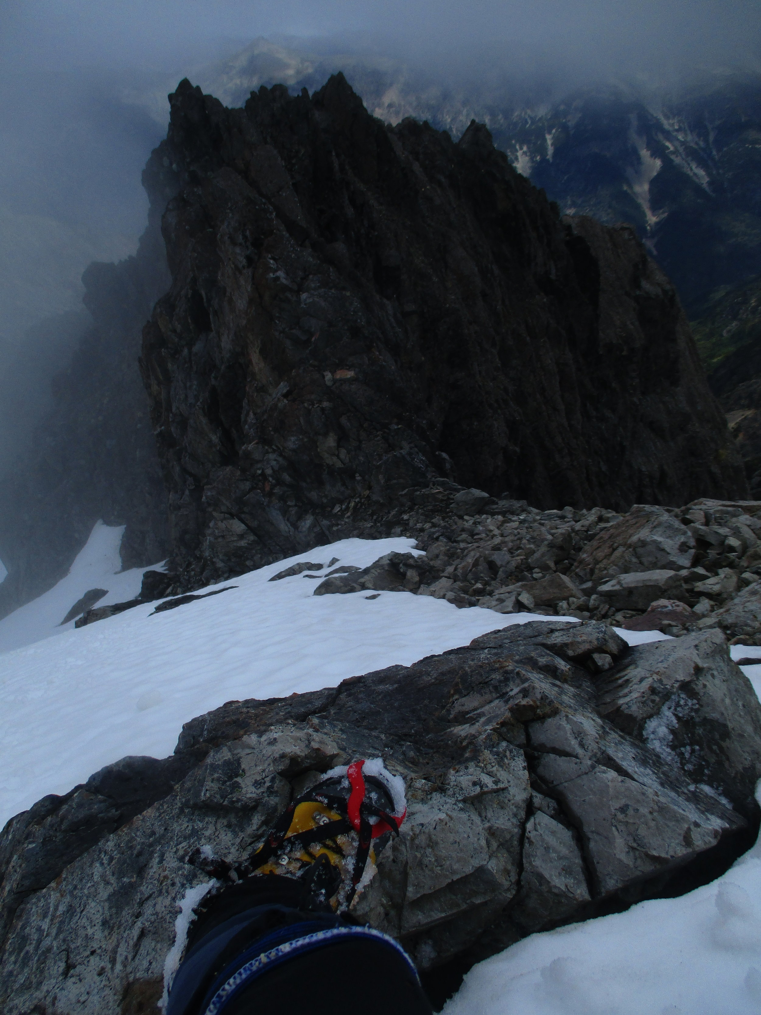 Oh oh, the wrong way up!! looking down increasingly steep slopes, Siberia valley on the right was the misnamed one this day as my route below was the one in clag and snow showers..