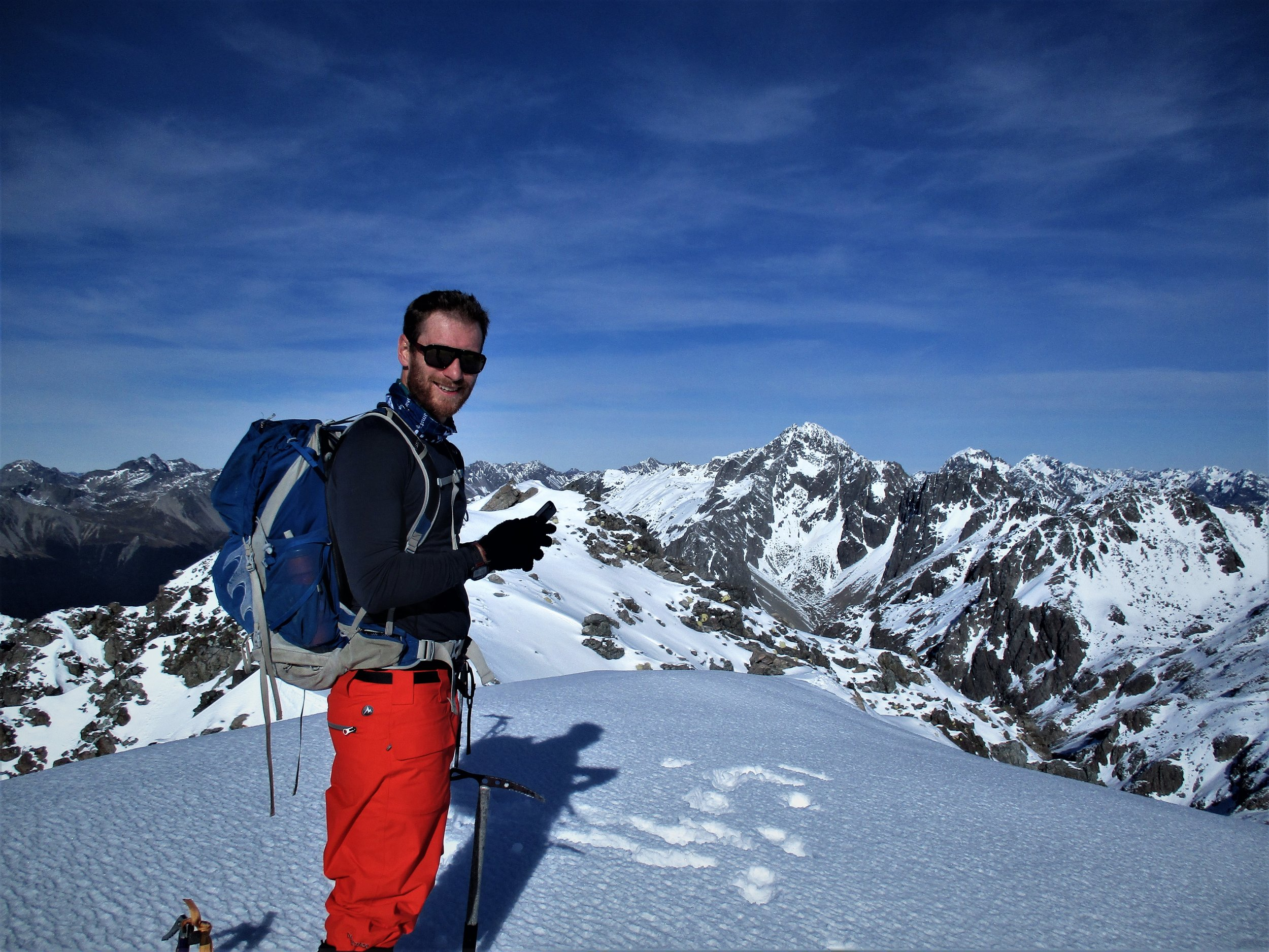 Dave on top of Alps, Mount Hopeless behind