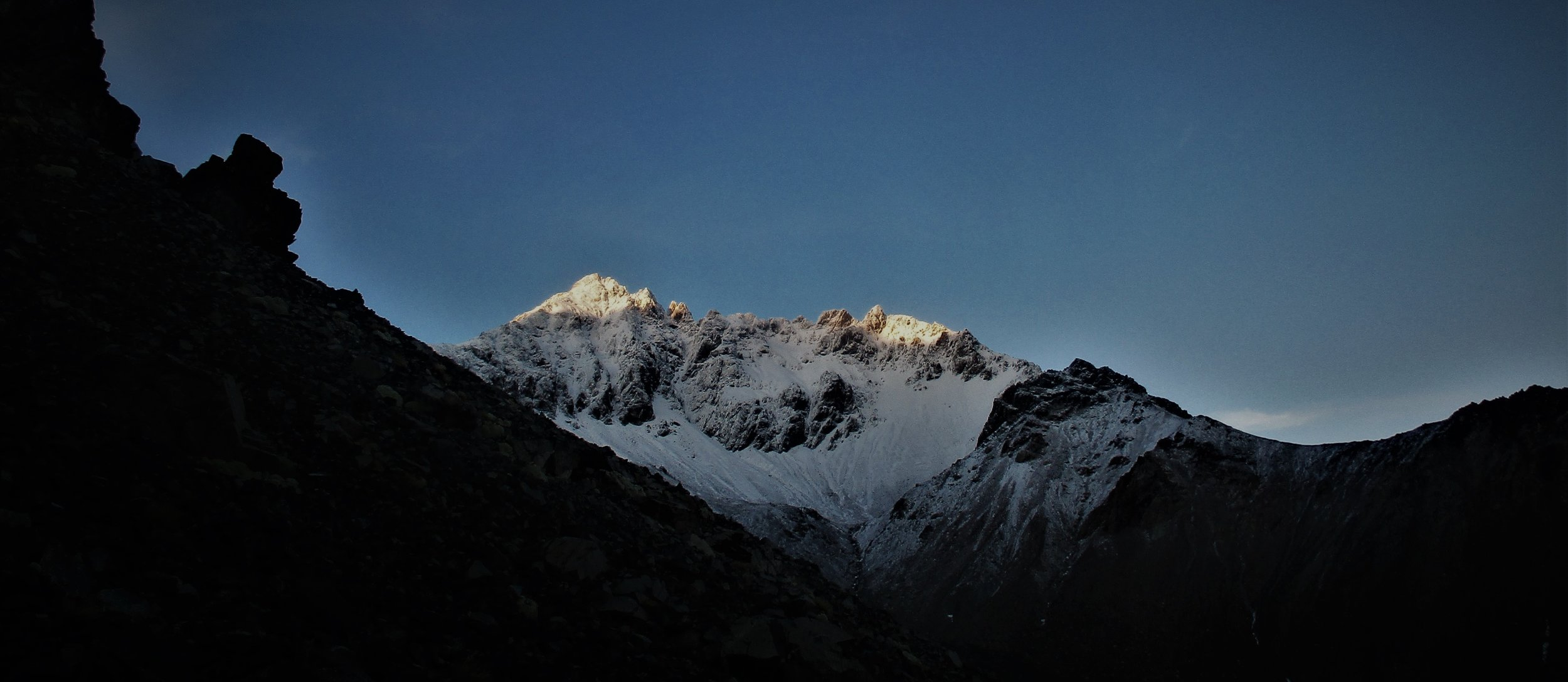 Mount Alarm is defined by early winter ice at dawn during the ascent of Mt Tapuae-o-Uenuku