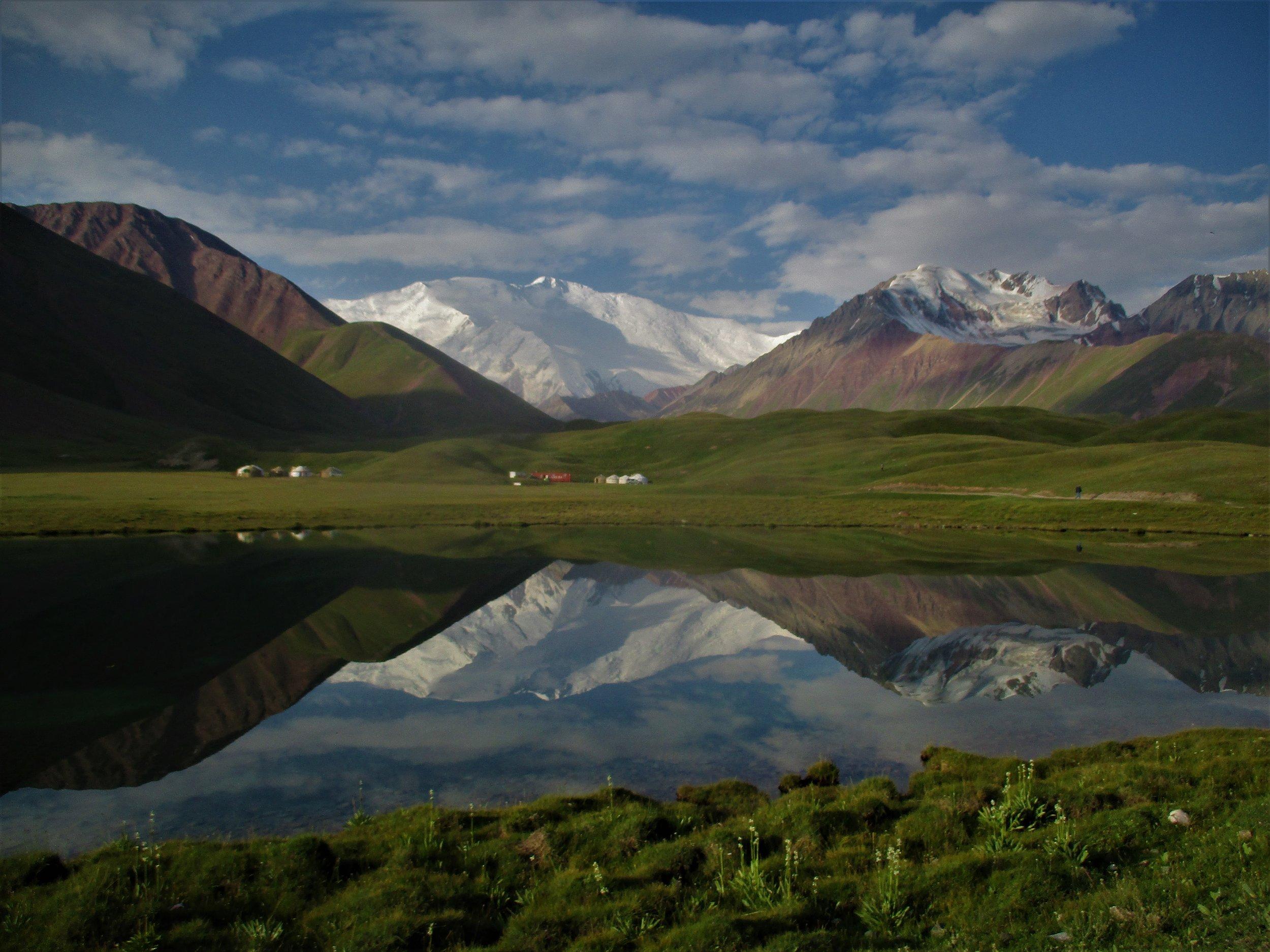 Peak Lenin rises above Tuplar Kul Lake at dawn