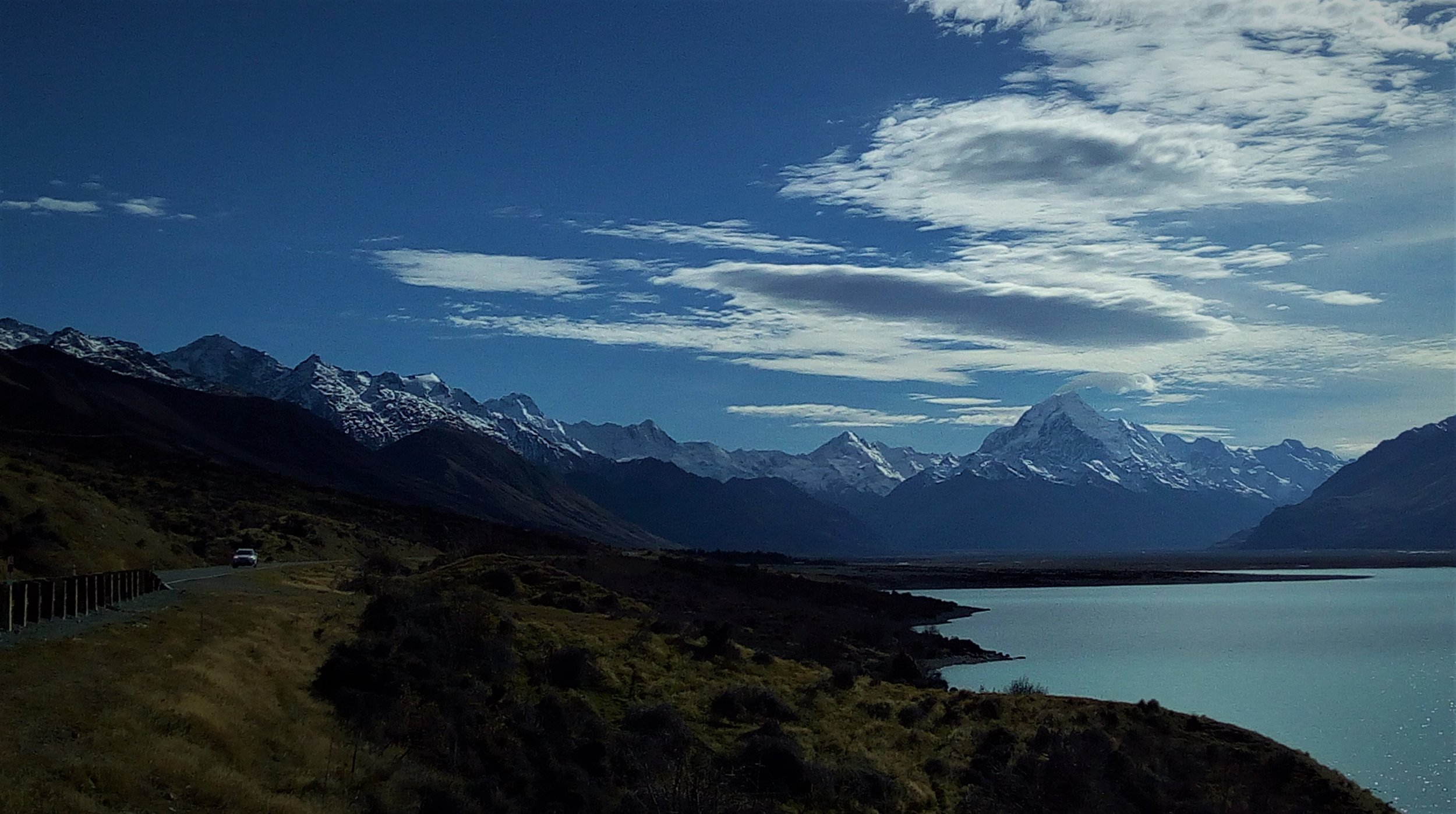 Heading along Lake Pukaki to Mount Cook (centre picture) National park