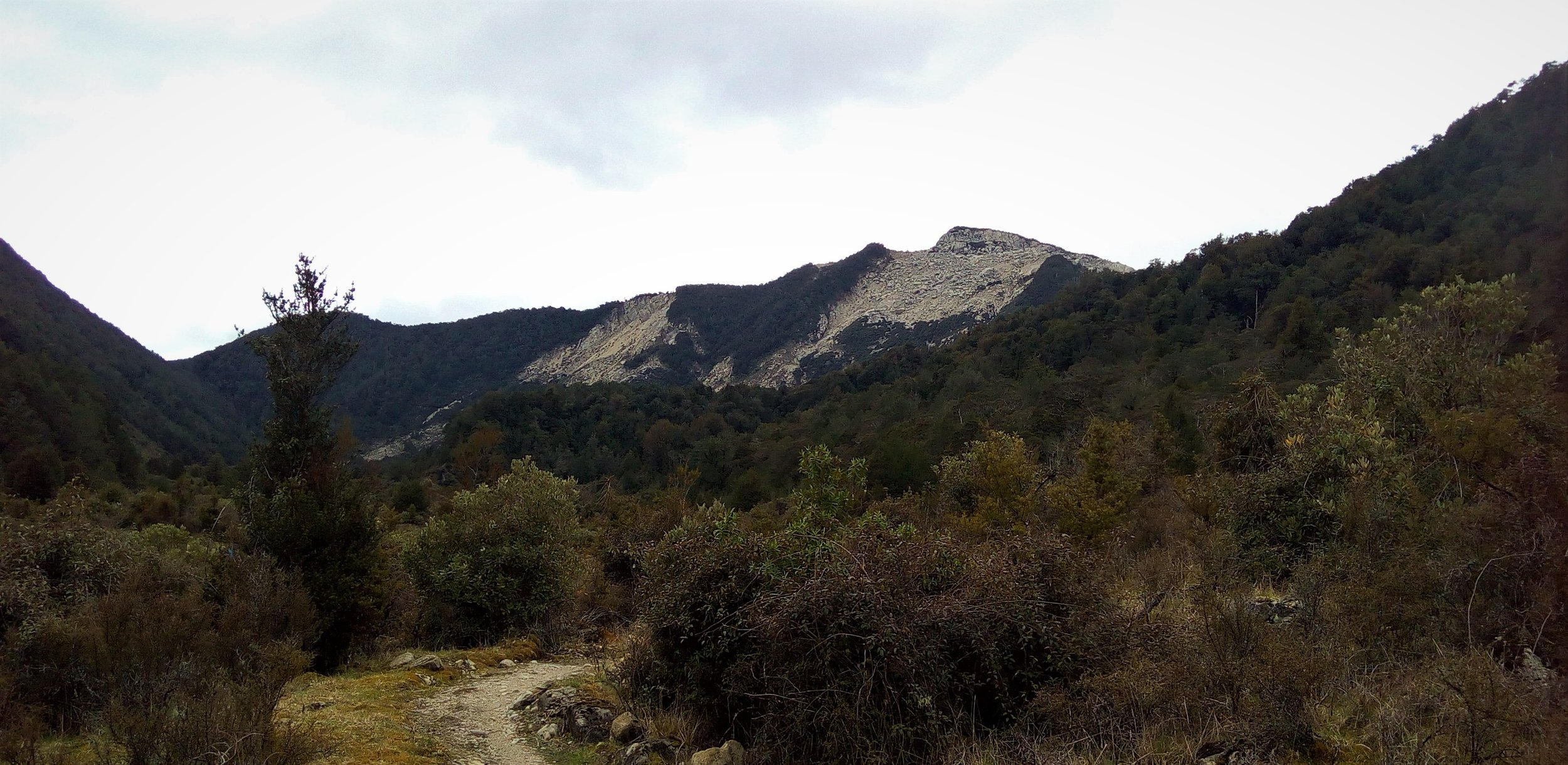 A broken mountain , large land slides throughout the track from earthquakes.
