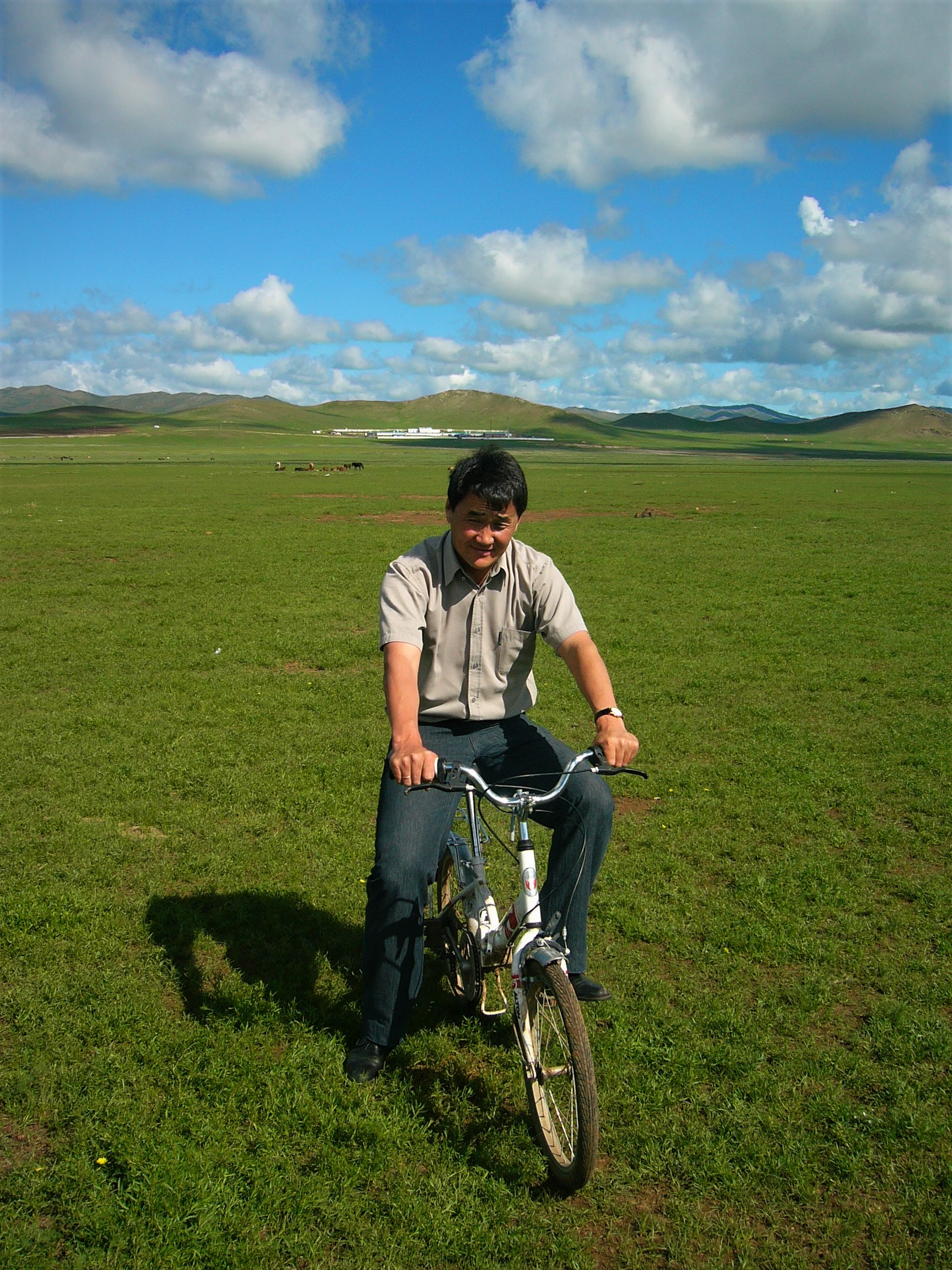 Oggi , on a bike !! This picture taken during my last visit to Mongolia over 10 years ago on the rolling steppes west of Ulan Batar.