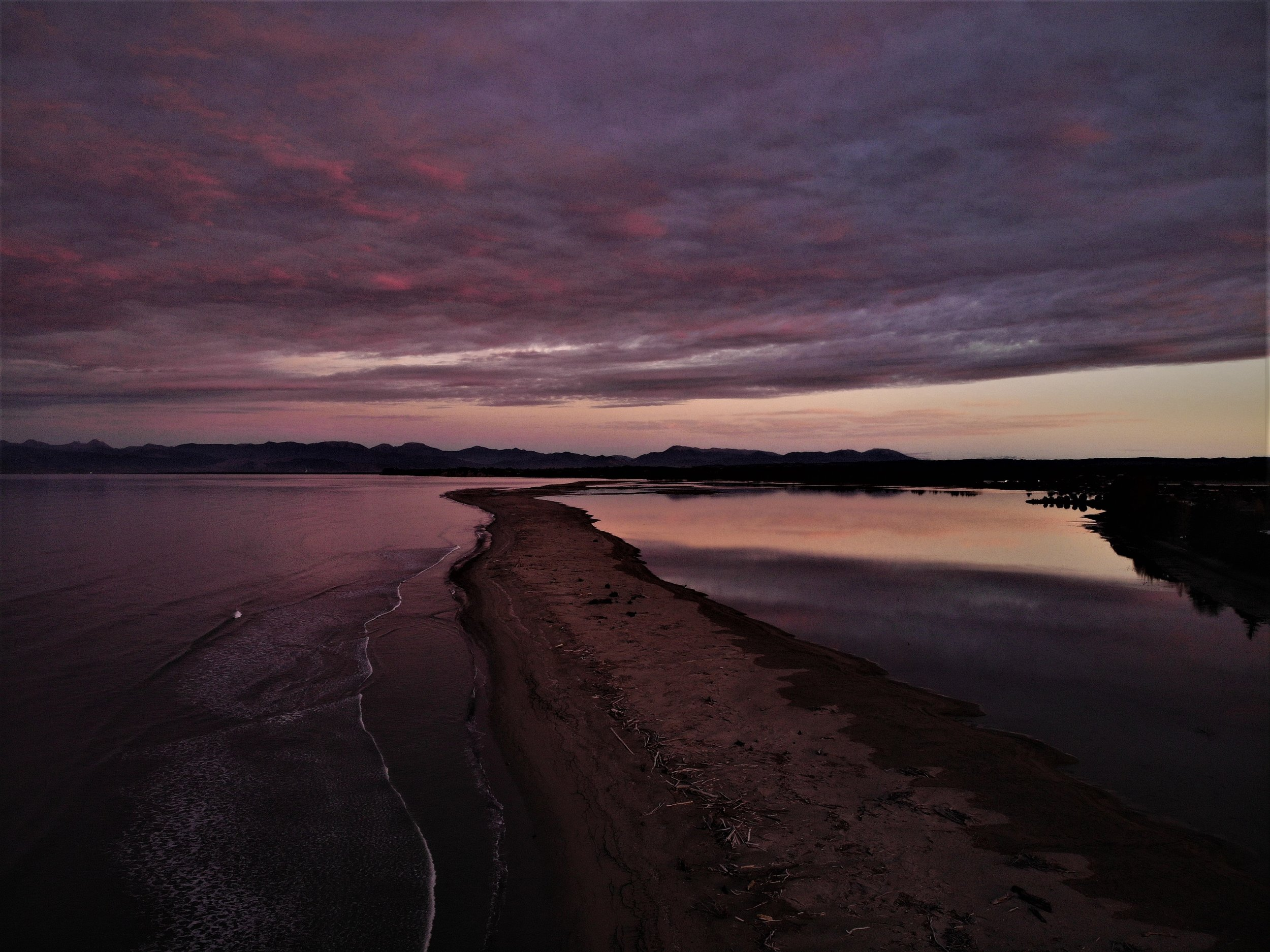 Flying the drone over the Mouteka sand spit at dusk.